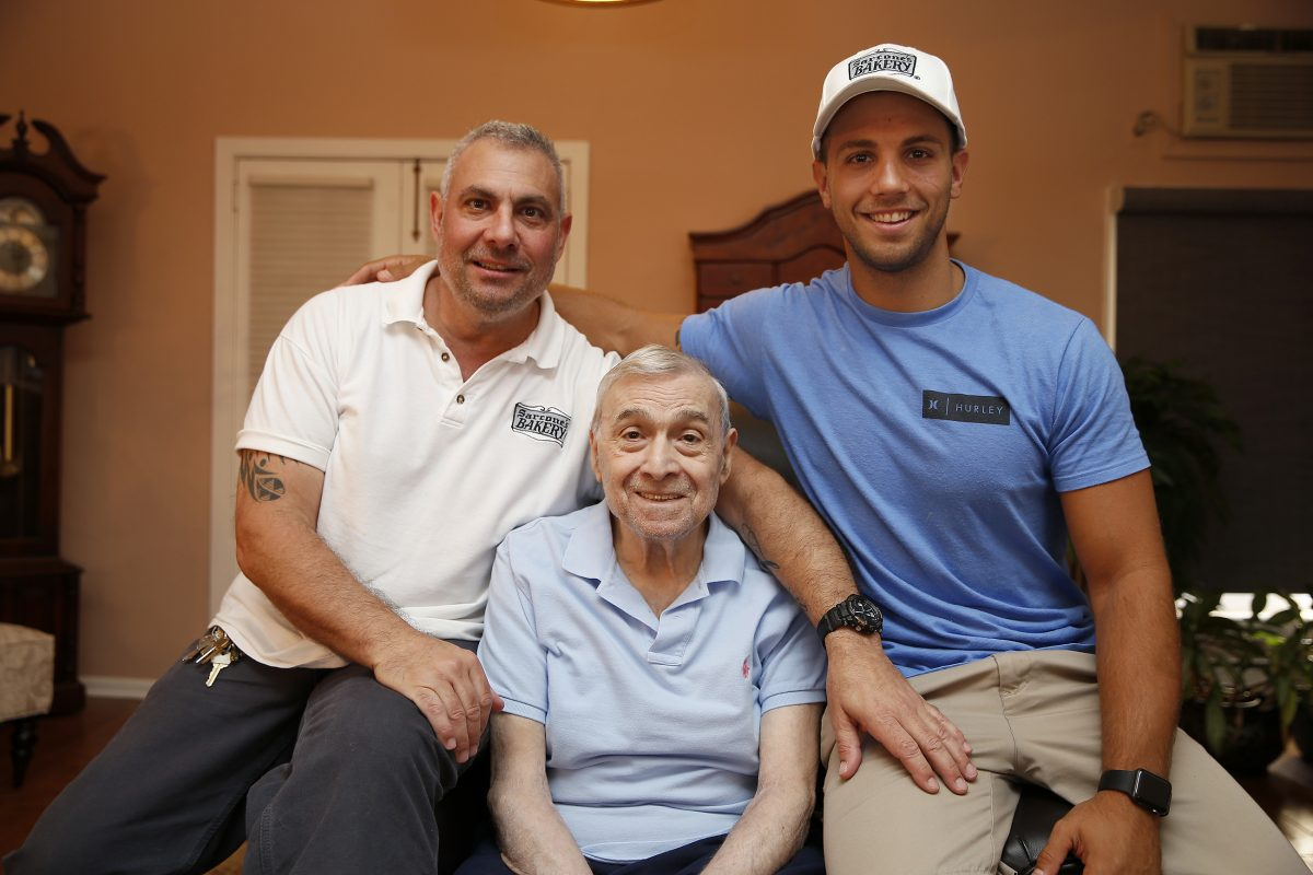 Louis Sarcone Jr. (left) and his son Louis 3rd with the head of the family, Louis Sarcone Sr. in his home above their business, Sarcone's Bakery in Philadelphia.
