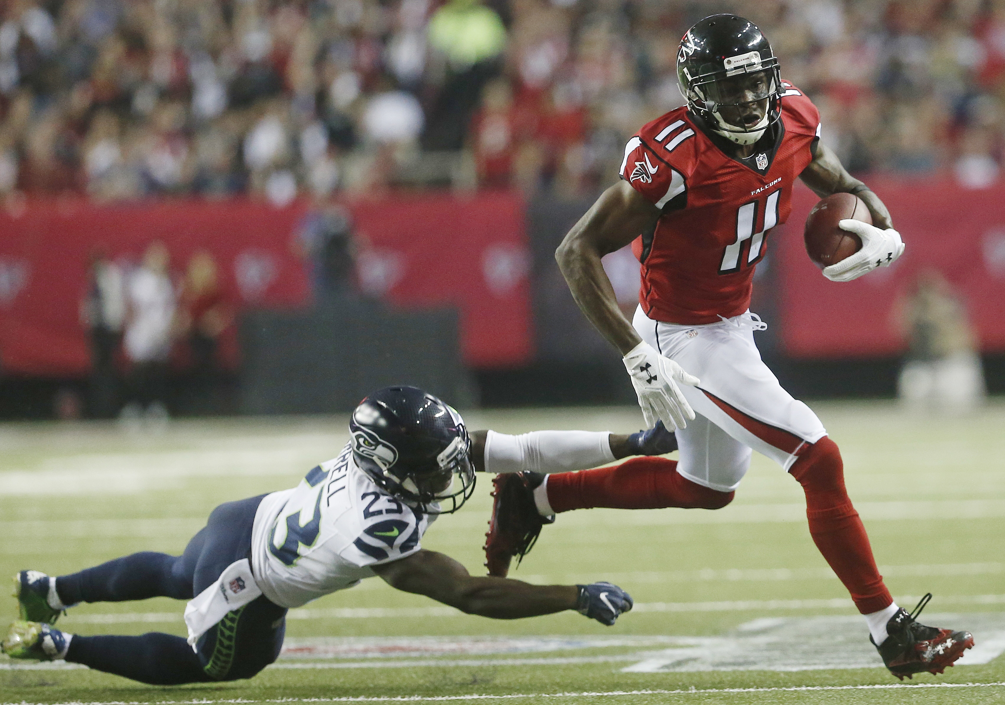Atlanta Falcons wide receiver Julio Jones (11) runs past Seattle Seahawks free safety Steven Terrell (23) during the first half of an NFL football divisional football game, Saturday, Jan. 14, 2017, in Atlanta. (AP Photo/John Bazemore)