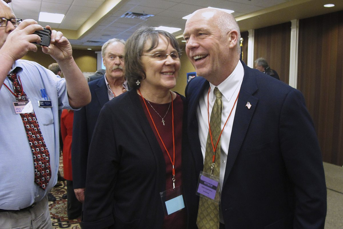 In this March 6, 2017, file photo, Greg Gianforte, right, receives congratulations from a supporter in Helena, Mont. Montana voters are heading to the polls Thursday, May 25, 2017, to decide a nationally watched congressional election amid uncertainty in Washington over President Donald Trump's agenda and his handling of the country's affairs.