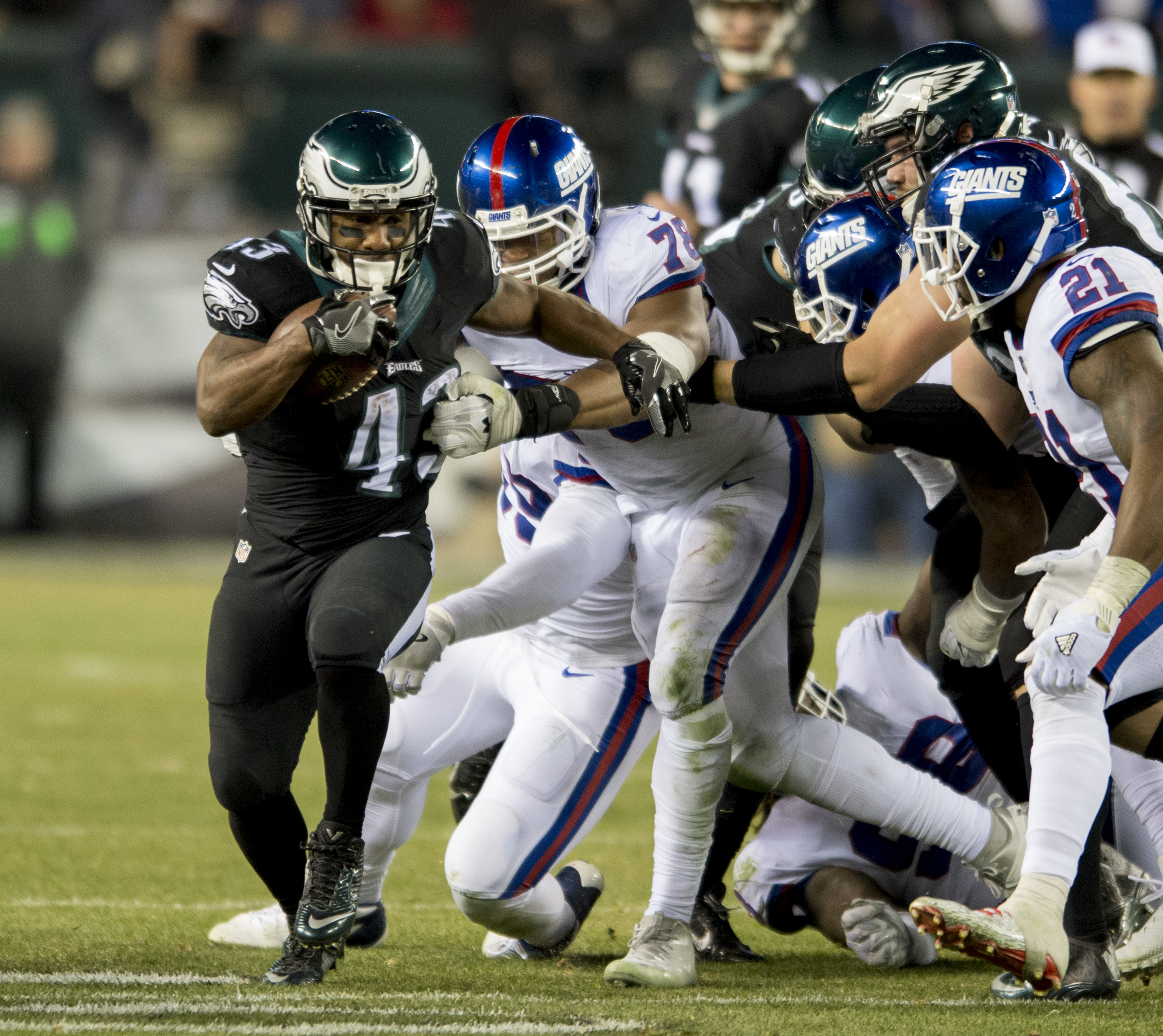 Eagles running back Darren Sproles busts through the Giants defensive line in the 4th quarter of the Eagles 24-19 victory at Lincoln Financial Field December 22, 2016. Sproles carried 7 times for 40 yards in the win. CLEM MURRAY / Staff Photographer