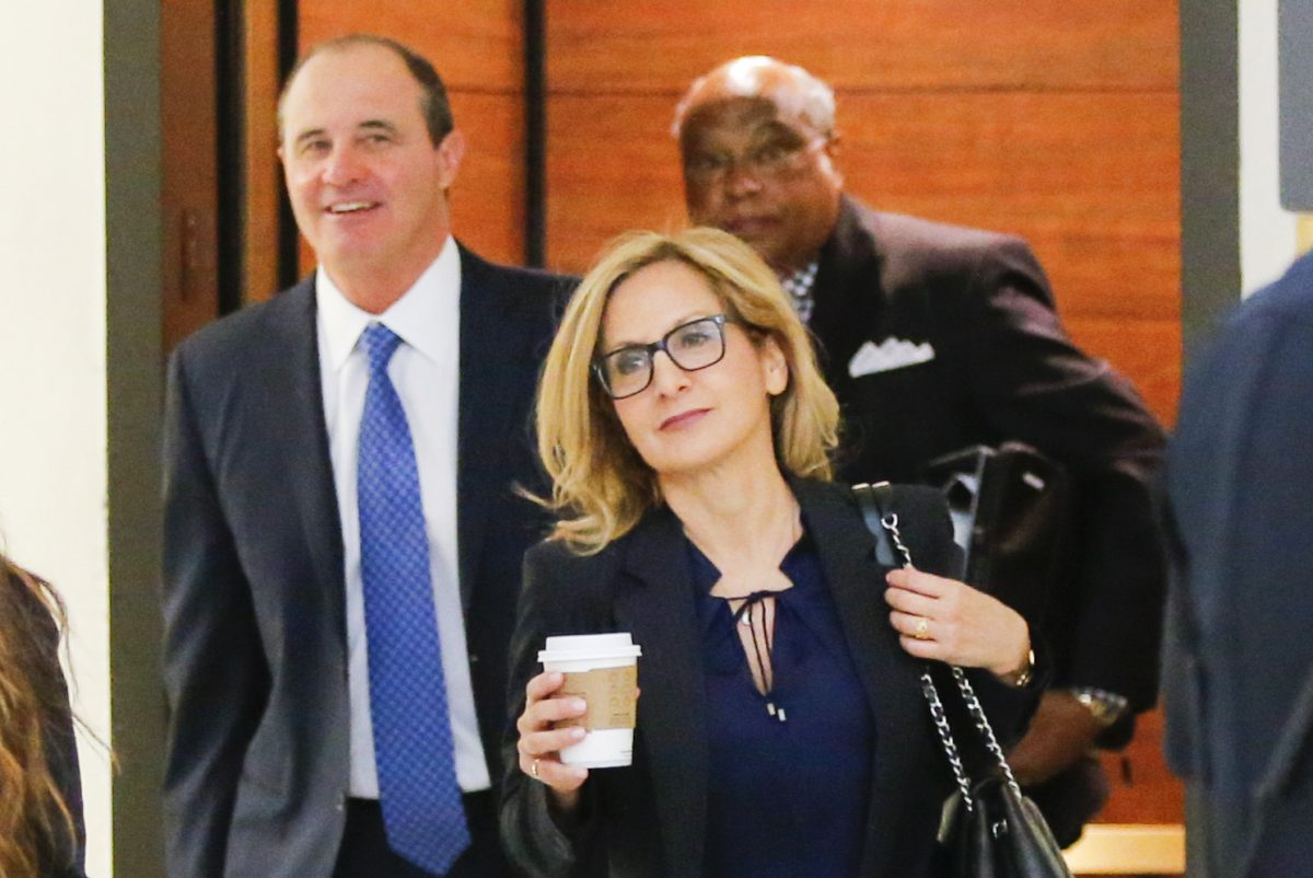 Bill Cosby's attorney Angela Agrusa (,center) arrives at the Montgomery County Courthouse  in Norristown during the trial in June. On Tuesday, she asked a Montgomery County judge to let her withdraw from the case.