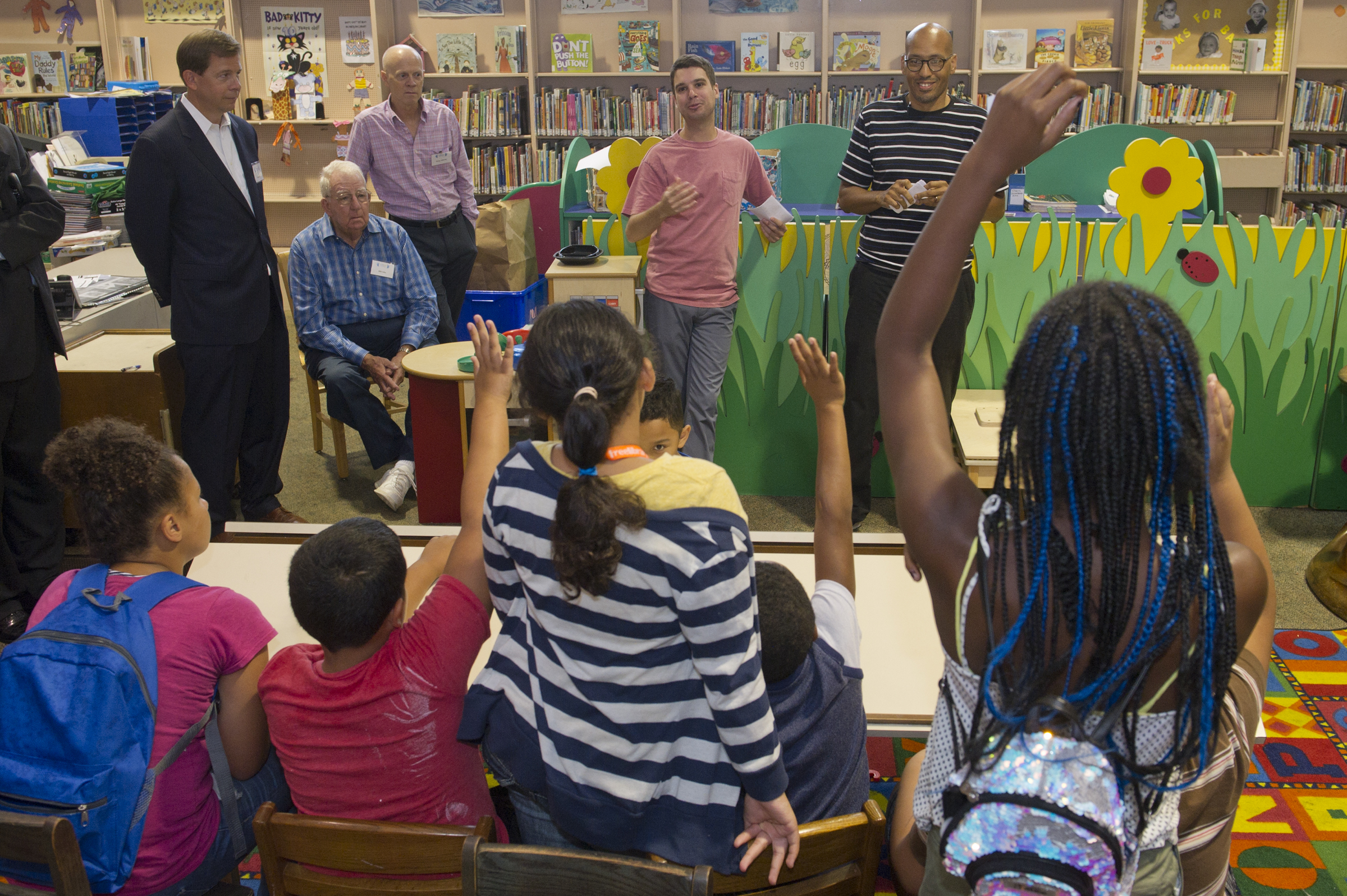 August 15, 2017 -- CADE counselors Perry Mattero (left center, back) and Tony Smith (right, back) lead a discussion during a summer reading program for local kids at the McPherson Square Library in Kensington Tuesday. CADE, a local organization presents the program which encourages addiction prevention and healthy decision making. (Avi Steinhardt/ For the Philadelphia Inquirer)