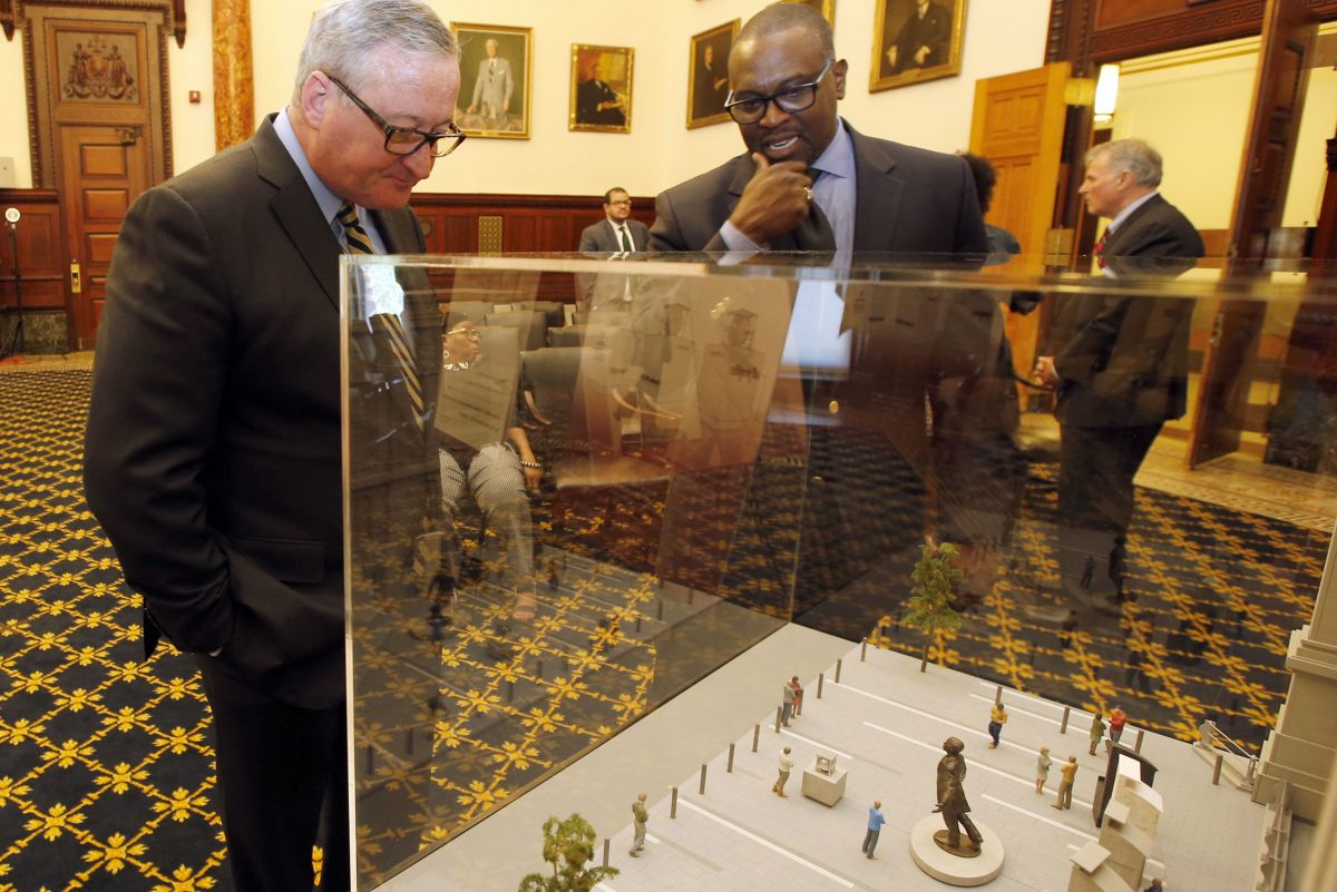 Sculptor Branly Cadet and Mayor  Kenney look over the model design for the Octavius Catto sculpture memorial.