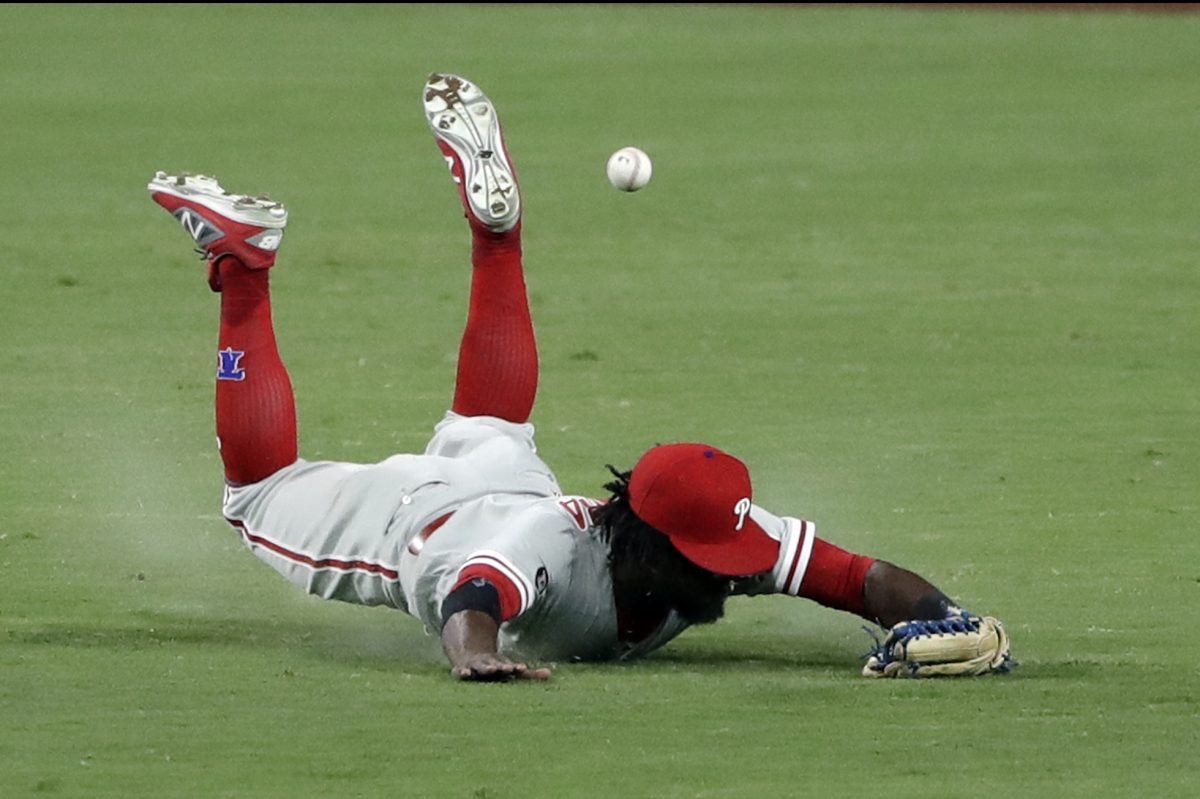 Phillies centerfielder Odubel Herrera can't reach an RBI single by San Diego's Austin Hedges during the sixth inning Monday.