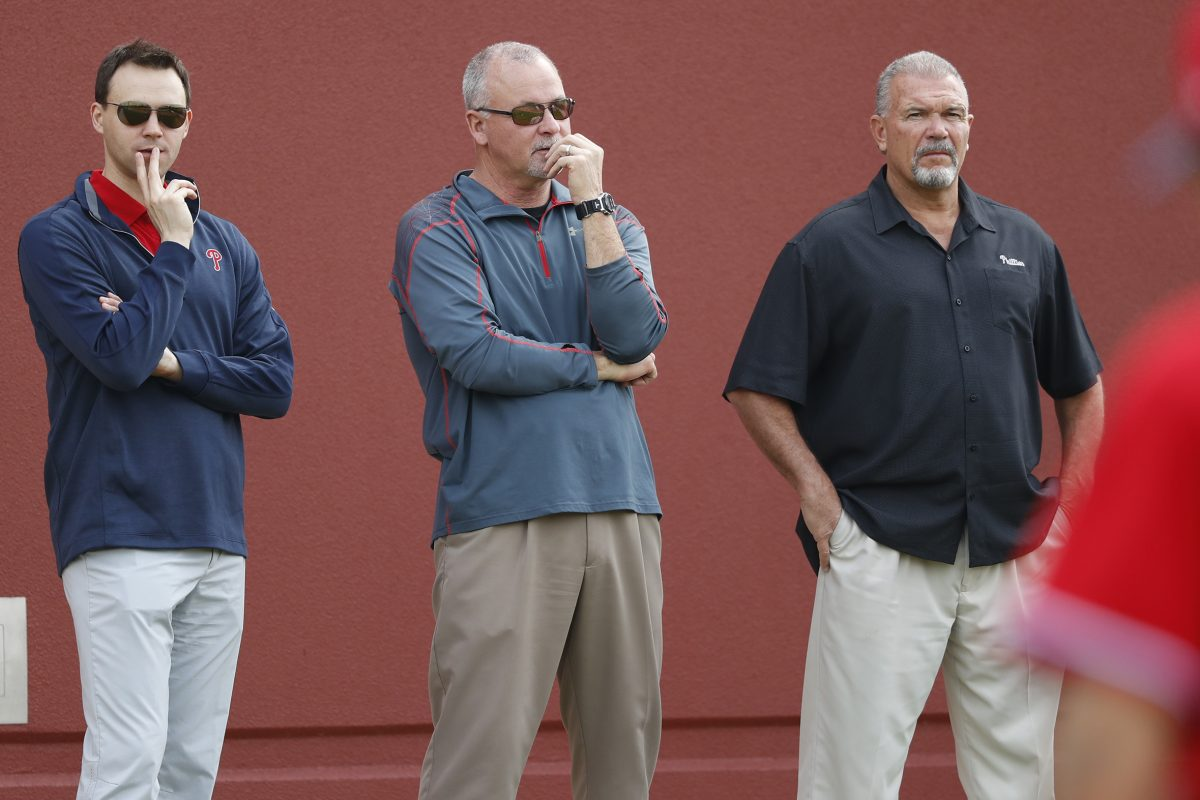 Phillies general manager Matt Klentak (left) and director of player development Joe Jordan (center) face a long-term absence from one of their top draft picks last summer.