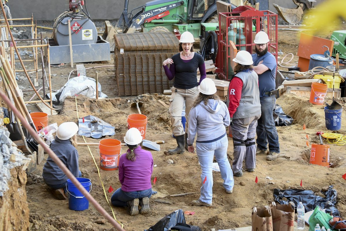 Volunteer archaeologists working in March to exhume bodies buried at the former First Baptist Church burial ground on Arch Street.