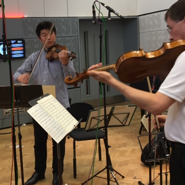 Violinist Kevin Lin (left) and Curtis Institute president Roberto Diaz rehearse at the BBC studios just before their scheduled performance was preempted by a call to clear the building.