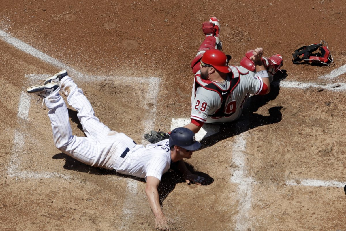 San Diego's  Wil Myers steals home ahead of the  tag by Phillies catcher Cameron Rupp in the fourth inning.