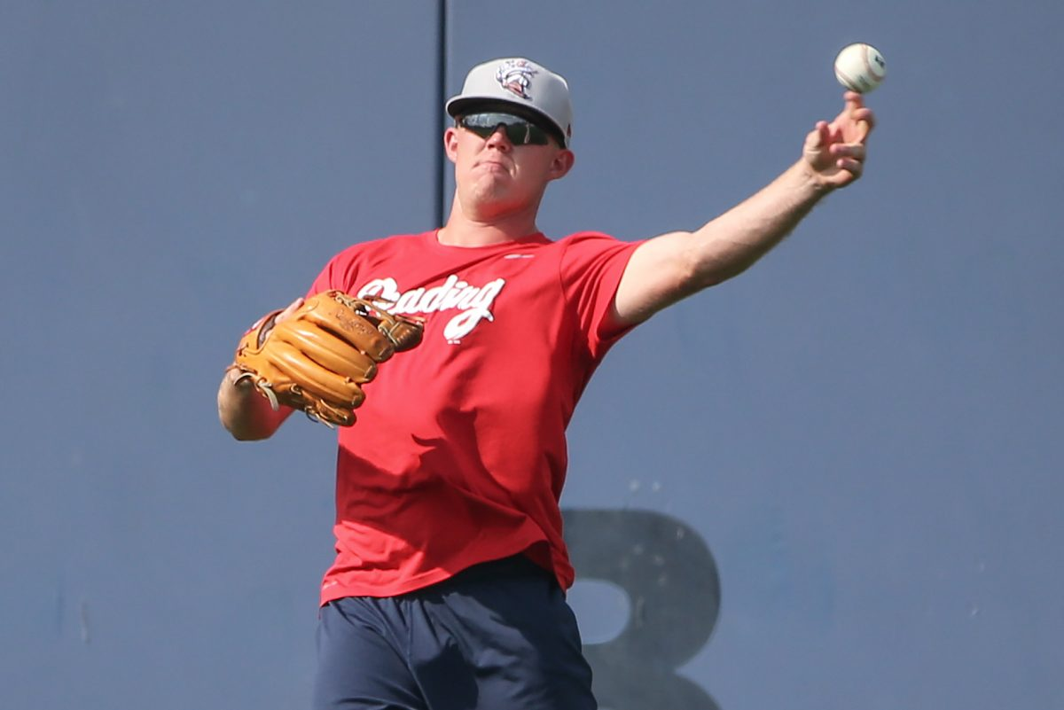 Reading Fightin Phils pitcher Garrett Cleavinger .shags fly balls before his game with the Harrisburg Senators on August 3, 2017.