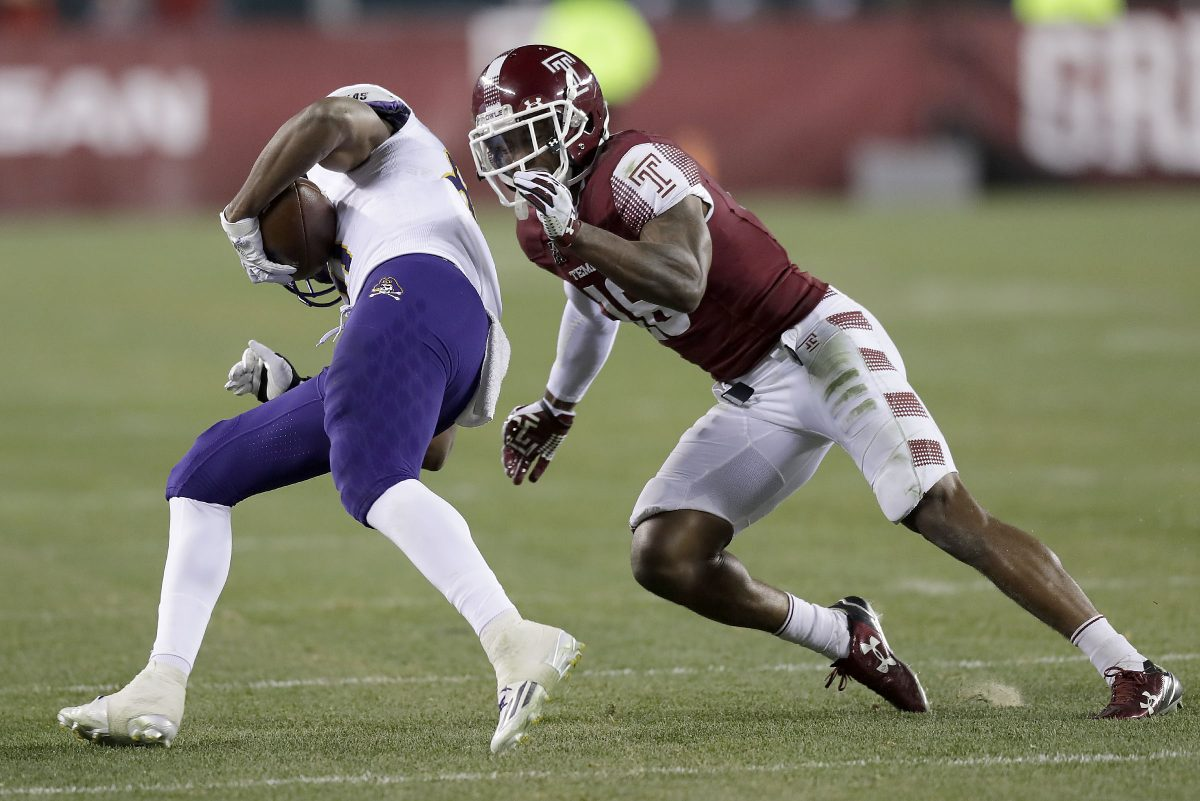 Temple's Artrel Foster goes after East Carolina wide receiver Jimmy Williams during a game last November.