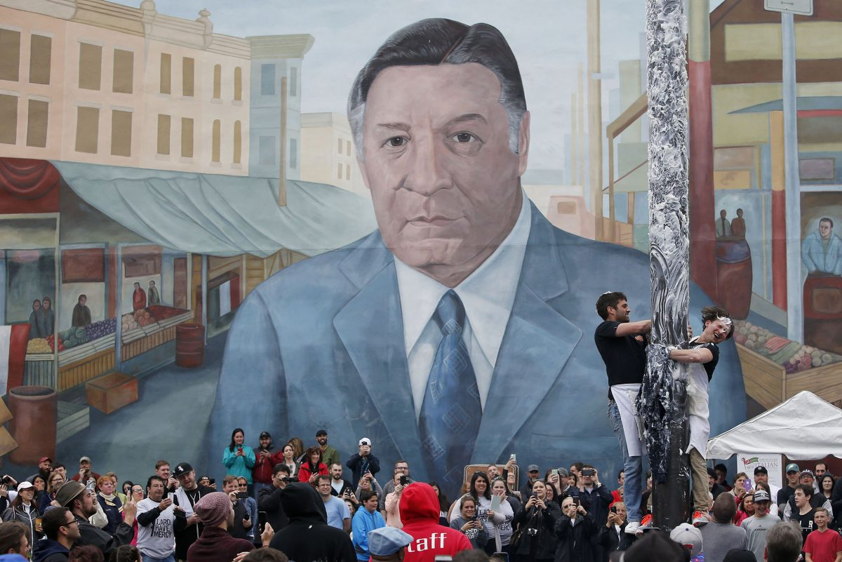 The mural of former Mayor Frank Rizzo looms over festivities at the Ninth Street Italian Market.