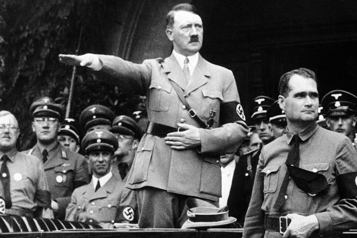 Adolf Hitler and his personal representative Rudolf Hess on Dec. 30, 1938. Minister of propaganda Joseph Goebbels is next to Hitler at left.