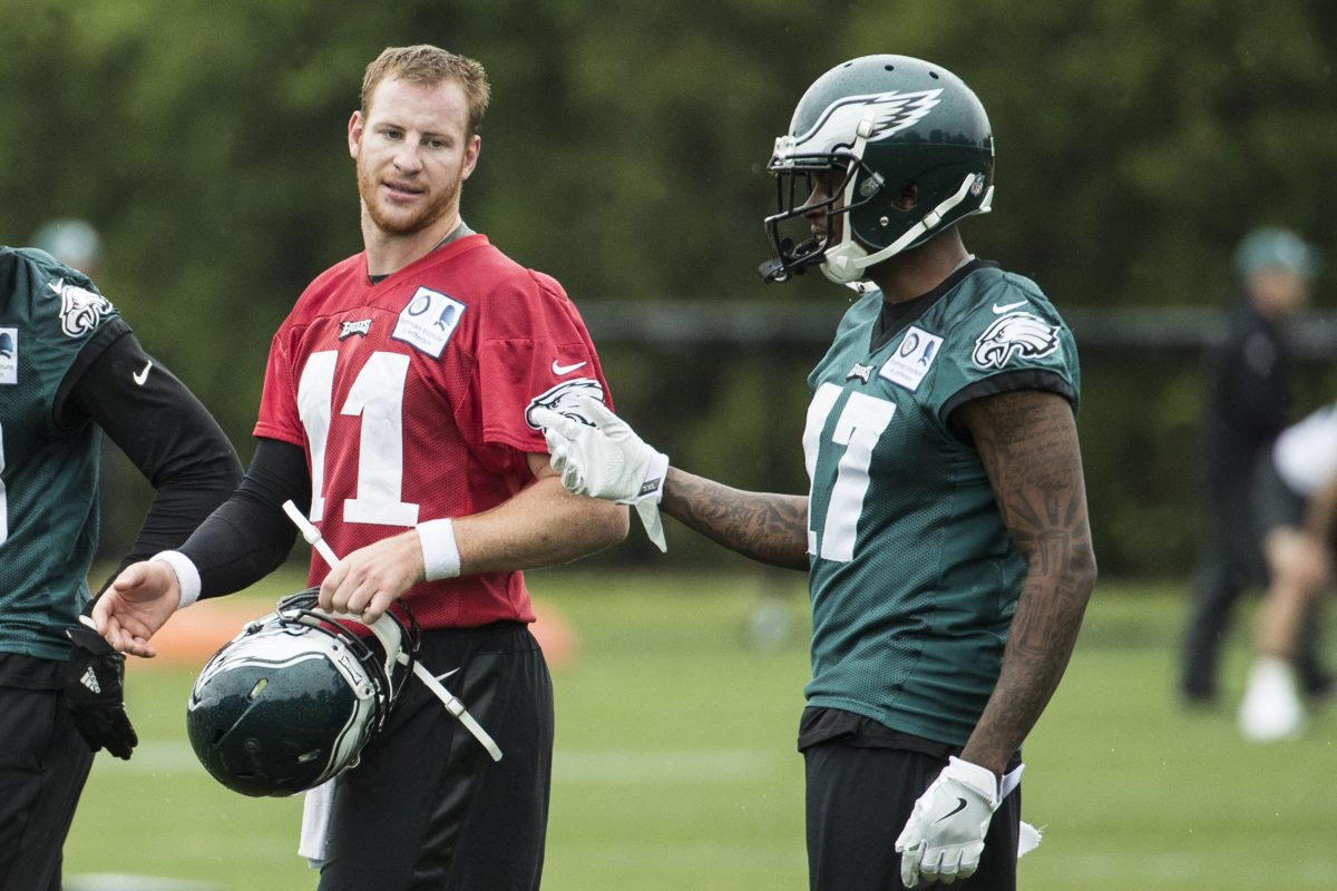 Eagles wide receiver Alshon Jeffery (17) talks things over with quarterback Carson Wentz during OTAs in May.