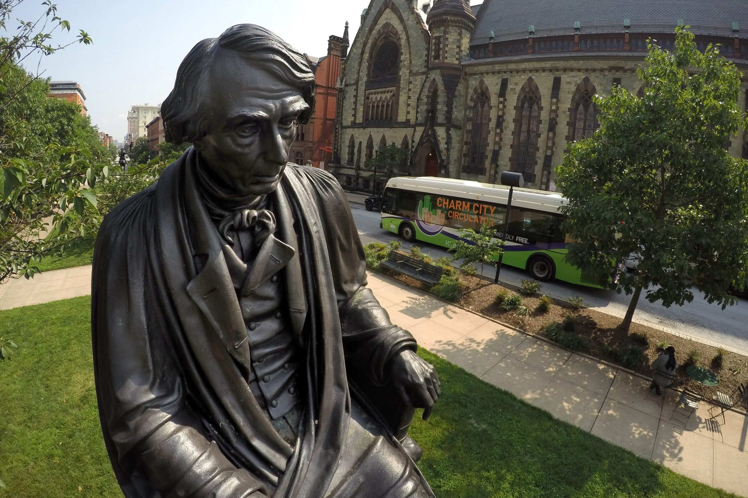 A statue of Roger Brooke Taney, the fifth Chief Justice of the U.S. Supreme Court, is seated facing the Washington Monument in Mount Vernon in this file image from 2015. (Jerry Jackson/Baltimore Sun/TNS)
