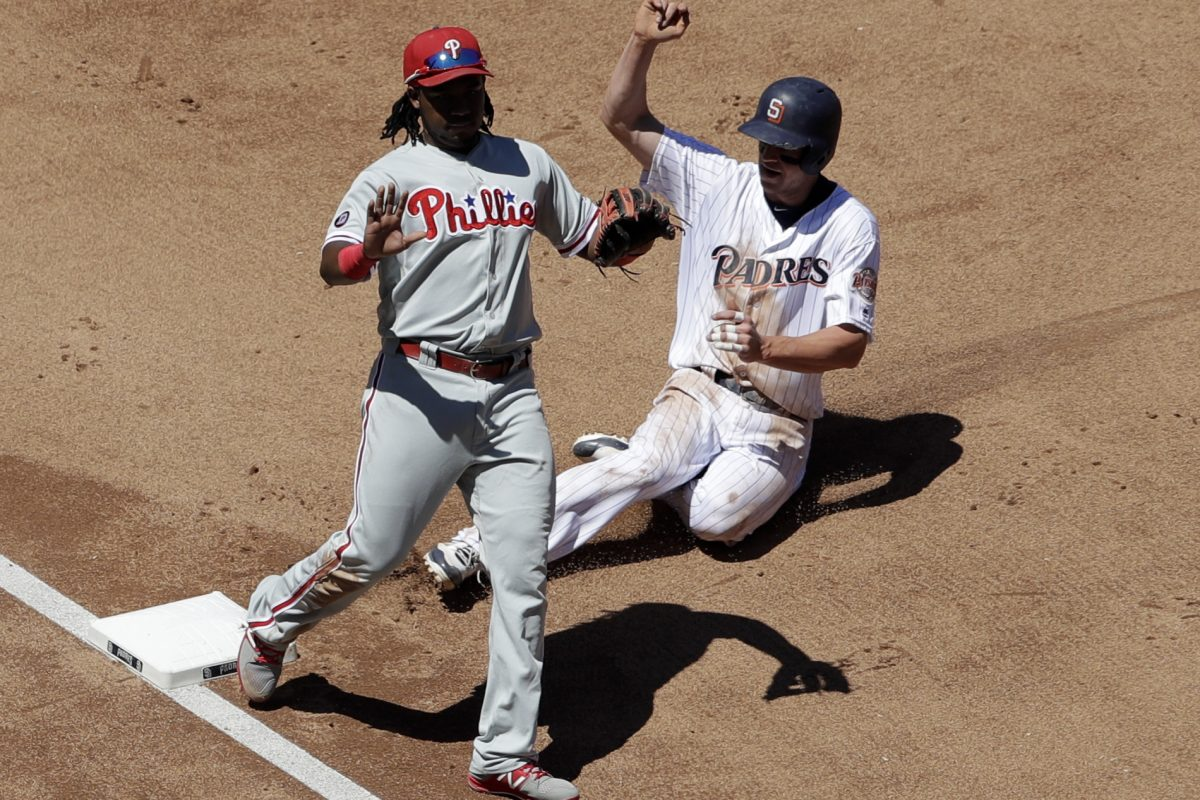 The Padres' Wil Myers steals third base Wednesday as third baseman Maikel Franco motions. Myers stole three bases in a row.