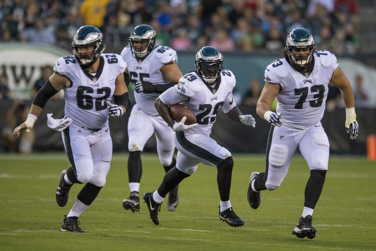 New Eagles running back LeGarrette Blount runs upfield with a reception following the blocks of Jason Kelce (left) and Isaac Seumalo (right) — with Lane Johnson bringing up the rear — in the 1st quarter as the Bills play the Eagles at Lincoln Financial Field August 17.