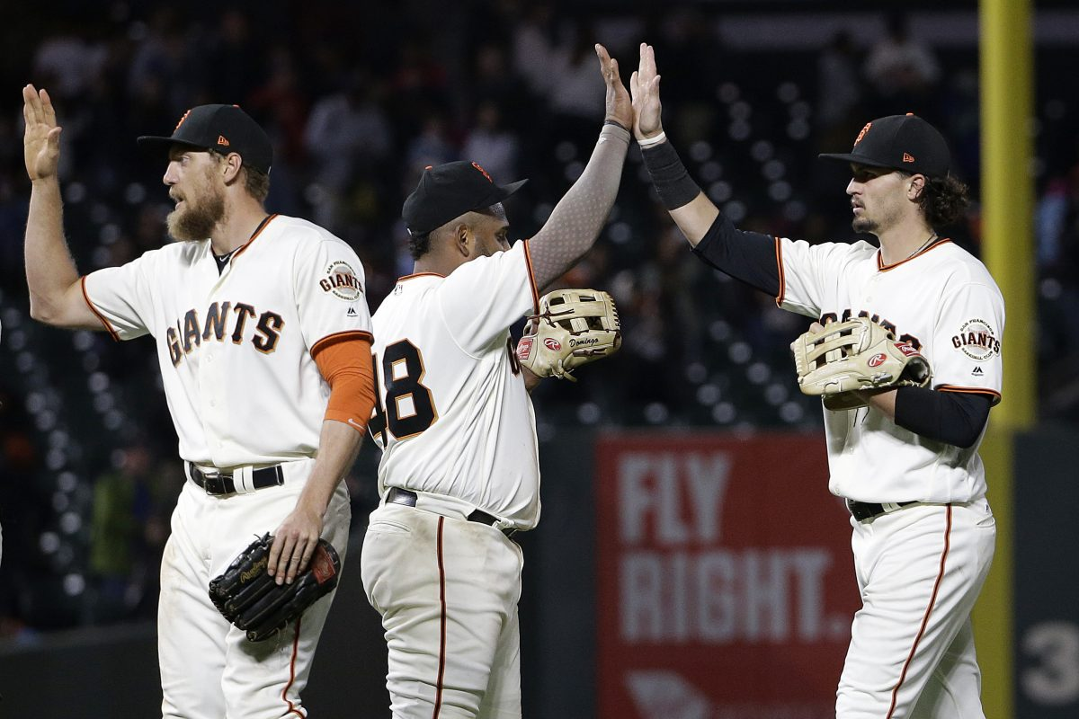 San Francisco Giants (from left) Hunter Pence, Pablo Sandoval and Jarrett Parker celebrate after a game against the Phillies in San Francisco, Thursday, Aug. 17, 2017. The Giants won, 5-4.