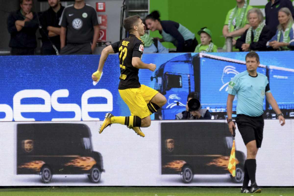 Hershey native and U.S. men's national soccer team star Christian Pulisic celebrates after scoring Borussia Dortmund's first goal of the Bundesliga season.