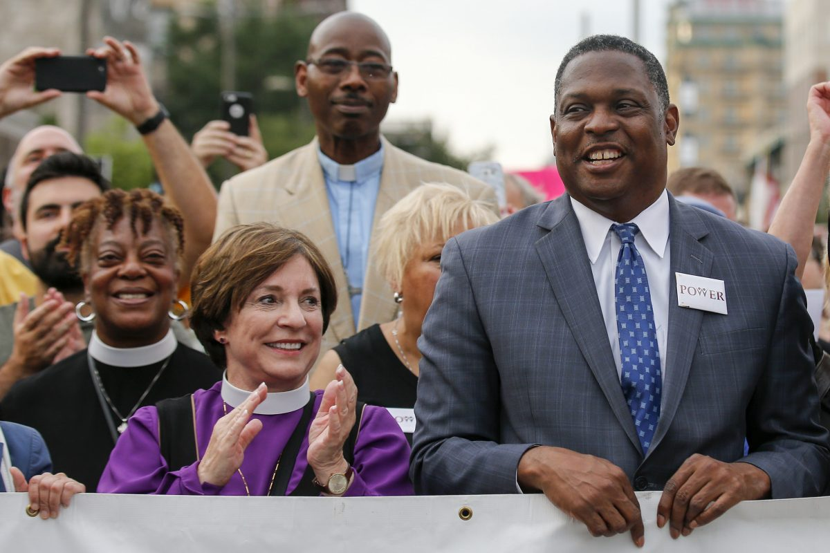 "The Rev. Gregory Holston (right) of POWER stands next to Bishop Claire Burkat of the Southeastern Pennsylvania Synod of the Evangelical Lutheran Church in America during the ""Philly Is Charlottesville"" demonstration in Philadelphia."