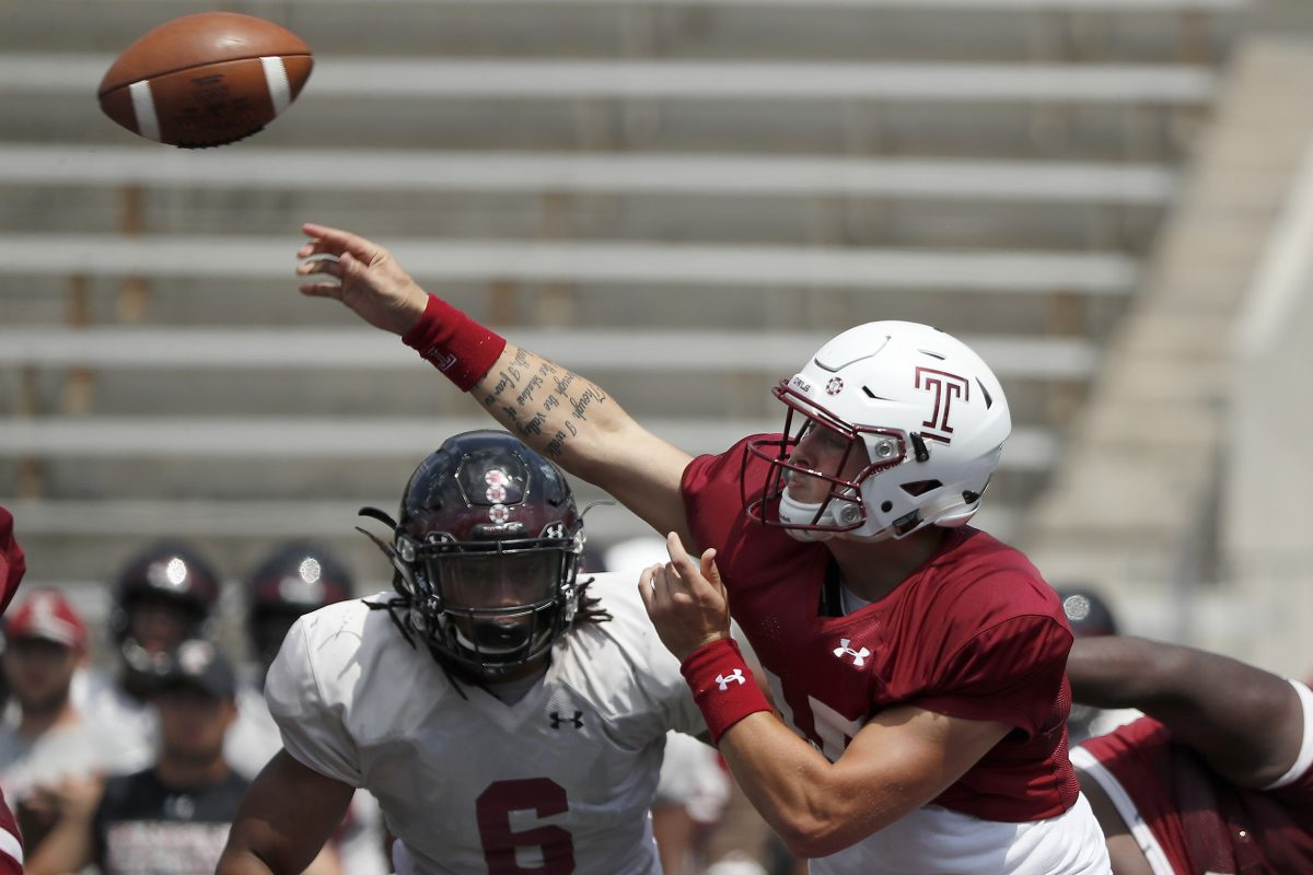 Temple's Anthony Russo throws as the Owls scrimmage at Franklin Field on Saturday.