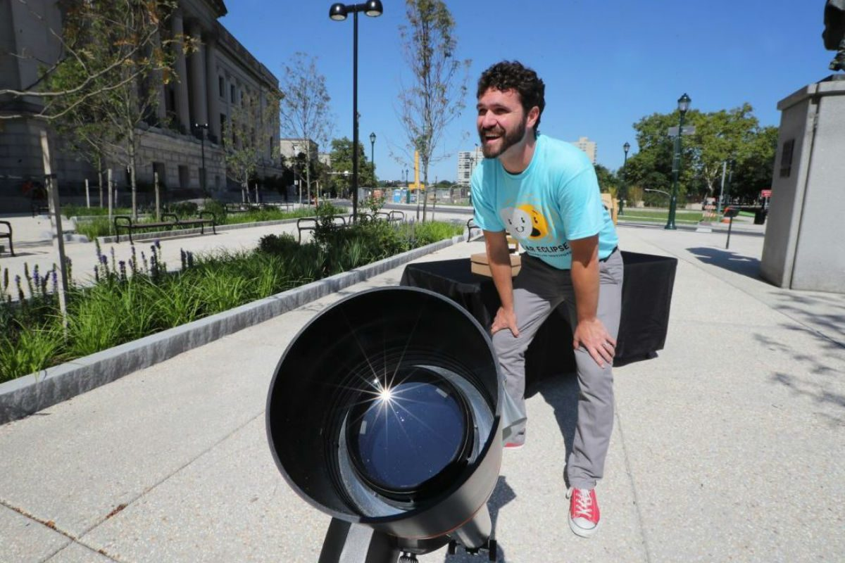 Expecting crowds for Monday's solar eclipse, Mickey Maley, assistant director of public programs at the Franklin Institute, spent Sunday readying dozens of projection telescopes and Sun Spotters.