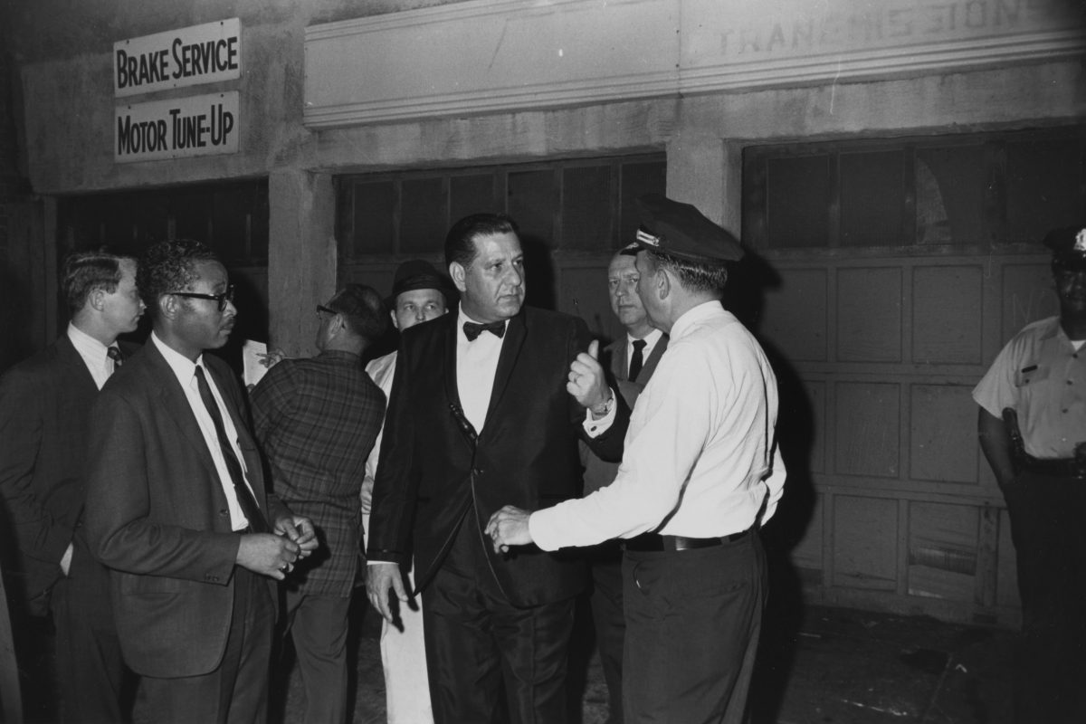 Tuxedo-clad Mayor Frank L. Rizzo with nightstick arriving to the scene of a disturbance in a low-income housing project in 1969.