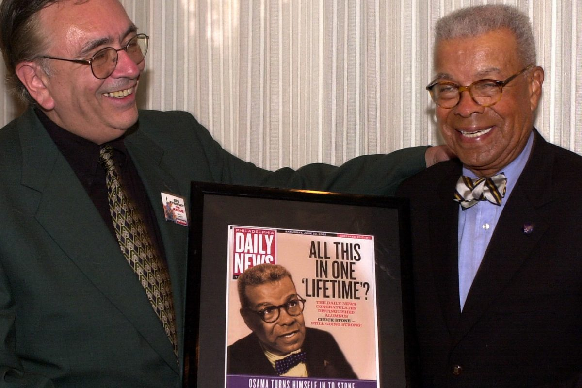 Stu Bykofsky (left) presents a memento to Chuck Stone at a journalism awards dinner in 2002 in Pittsburgh.