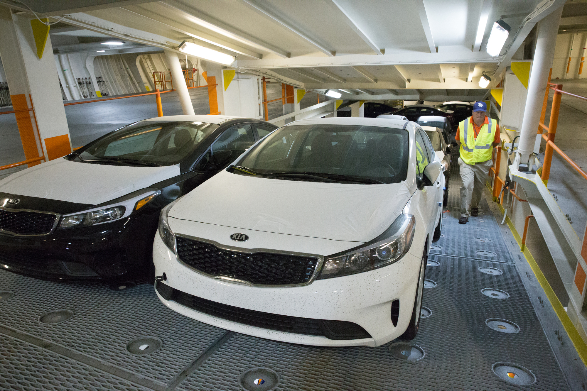 Automobiles inside the ship waiting to be unloaded at Pier 122 in Philadelphia, Friday. (JESSICA GRIFFIN / Staff Photographer)