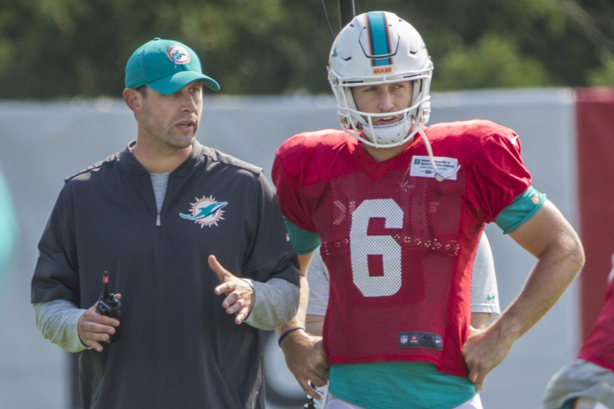 Dolphins head coach Adam Gase, left, talks things over with quarterback Jay Cutler, #6, right, during an offensive drill prior to the combined practice with the Philadelphia Ealges on Monday August 21, 2017. Philadelphia Eagles and the Miami Dolphins hold a combined practice on Monday.