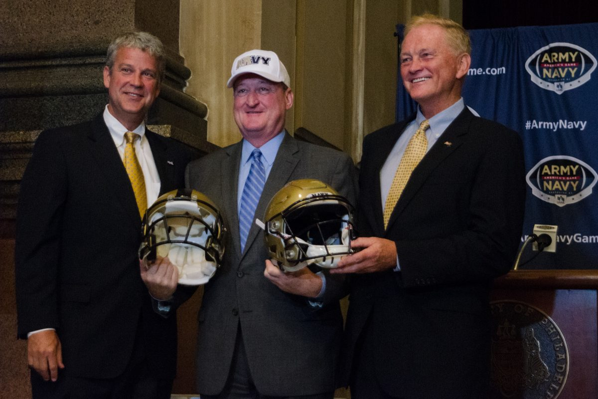 "Mayor Kenney, sporting an ""Arvy"" cap in support of both teams, stands between Chet Gladchuk (left), Navy athletic director, and Boo Corrigan, Army athletic director, at Tuesday's announcement."