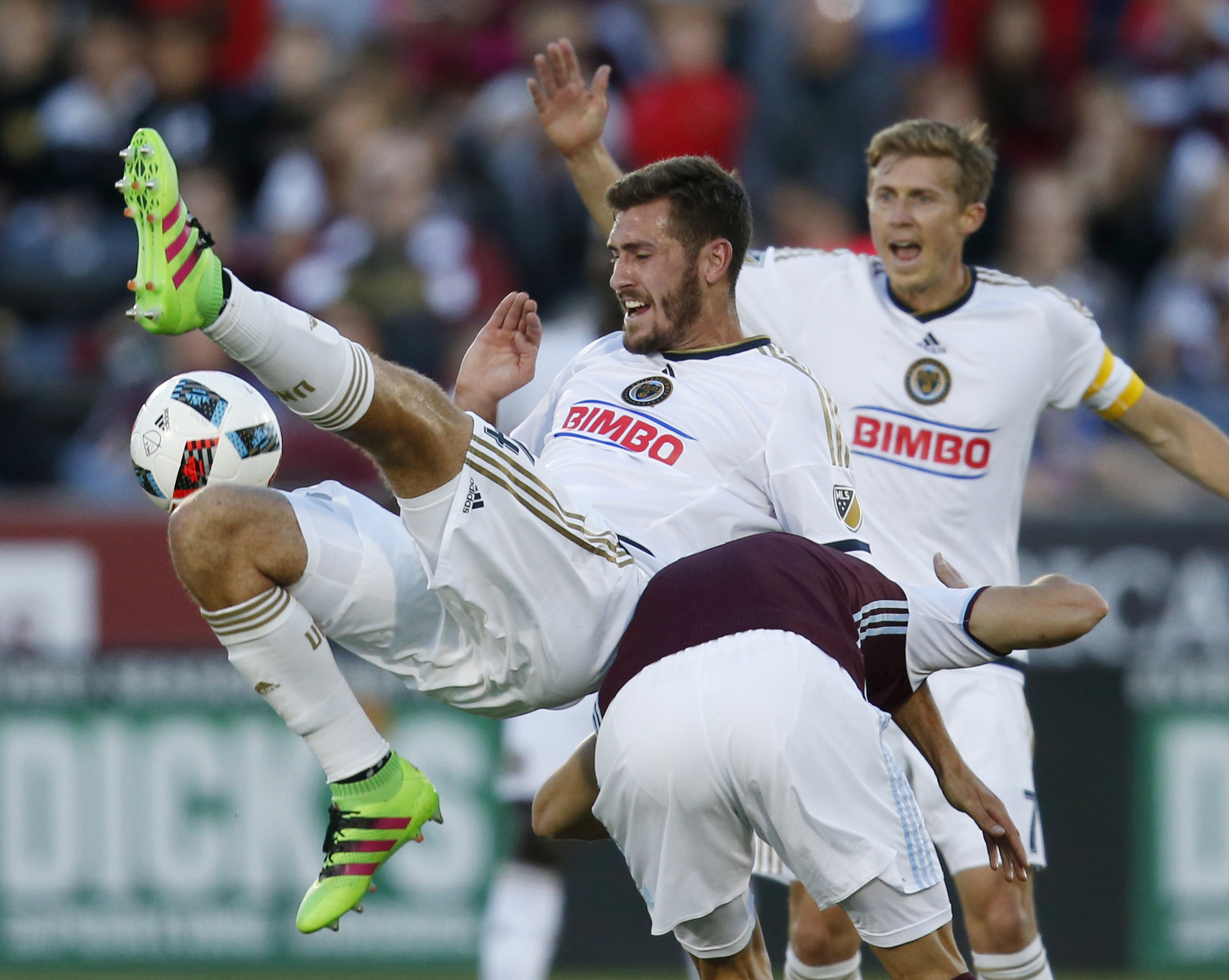 Philadelphia Union defender Ken Tribbett, left, collides with Colorado Rapids forward Luis Solignac, right, while trying to head the ball as Union midfielder Brian Carroll looks in this May 2016,file photo