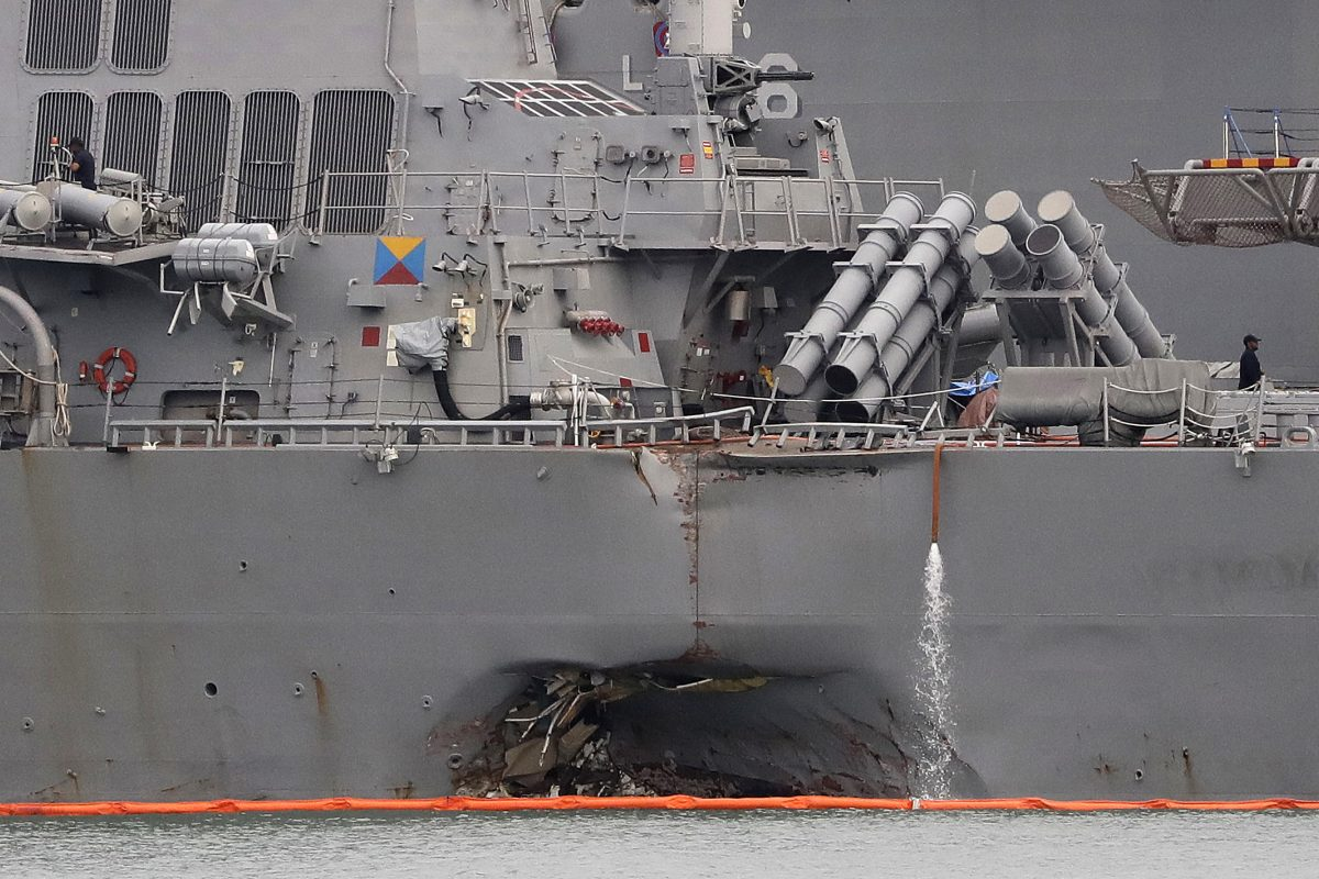 The damaged port aft hull of the USS John S. McCain.