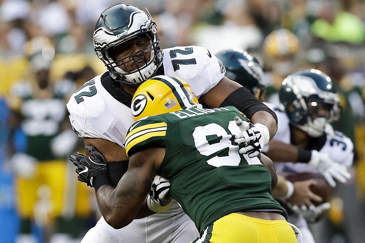 Eagles offensive tackle Halapoulivaati Vaitai blocks Packers linebacker Jay Elliott during a preseason game.