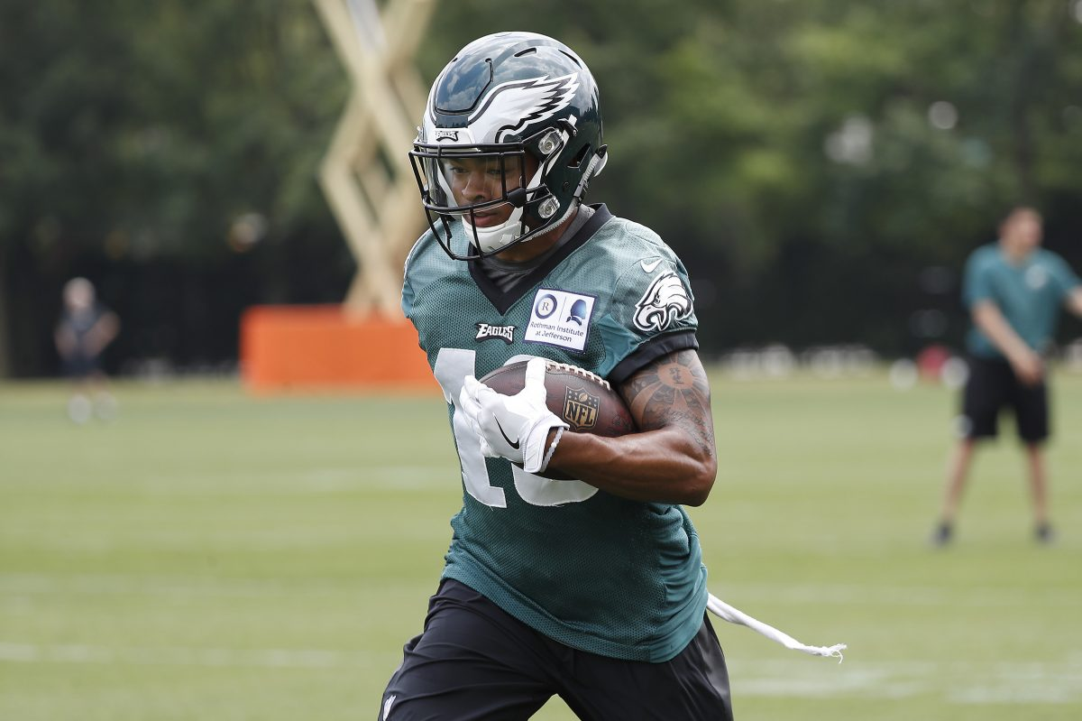 Bryce Treggs runs after he catches a pass during Eagles minicamp .