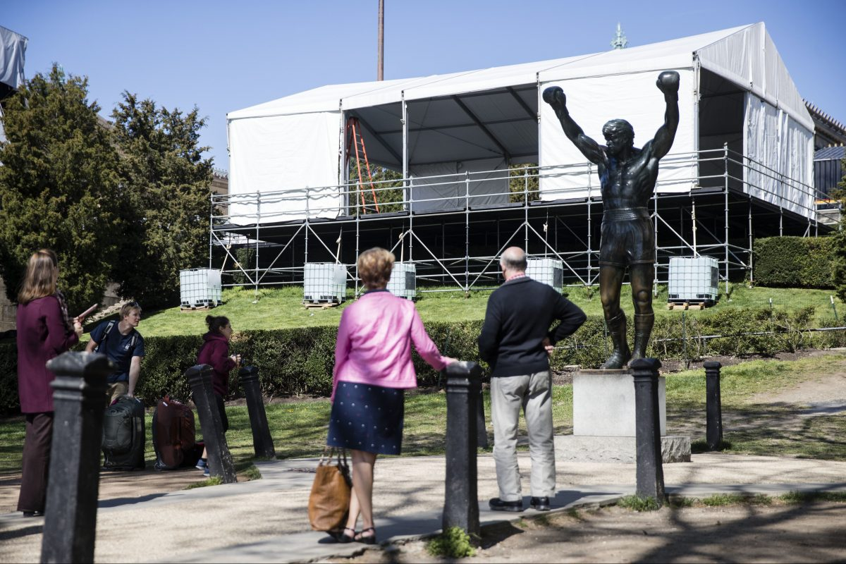 Tourists visit the Rocky statue during construction of the NFL draft stage in April. Now, it is the statue that will be closed to the public.