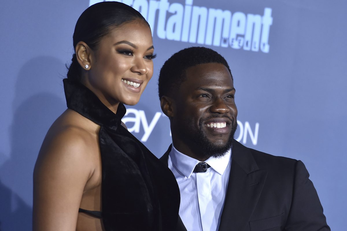 FILE – In this Dec. 11, 2016, file photo, Kevin Hart, right, and Eniko Parrish arrive at the 22nd annual Critics´ Choice Awards at the Barker Hangar in Santa Monica, Calif. Hart and Parrish announced on May 14, 2017, that they are expecting their first child together. (Photo by Jordan Strauss/Invision/AP, File)