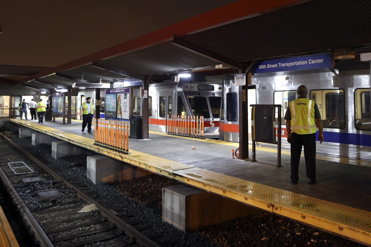 SEPTA officials look over damaged train cars on at the 69th Street Transportation Center in Upper Darby. According to SEPTA officials, a train from the Norristown High Speed Line arriving at the transportation center shortly after midnight struck an unoccupied train car that was sitting at the station platform.