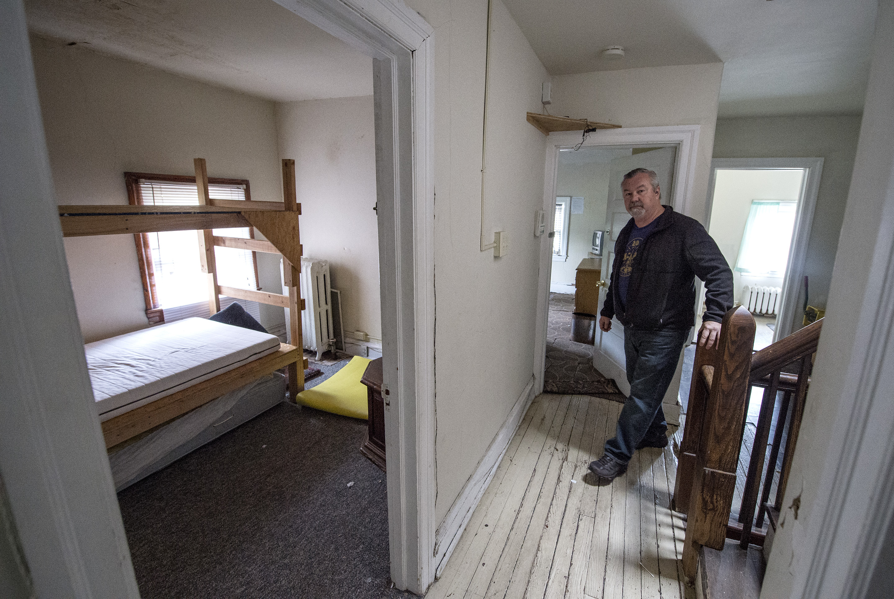 Jack O'Byrne walks to the 2nd floor of the church rectory, which will house the artists.