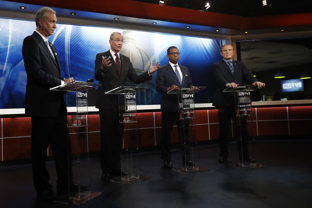 Candidates, from left, Assemblyman John Wisniewski, Phil Murphy, Jim Johnson and Sen. Ray Lesniak attend a Democratic gubernatorial primary debate in Newark, N.J.