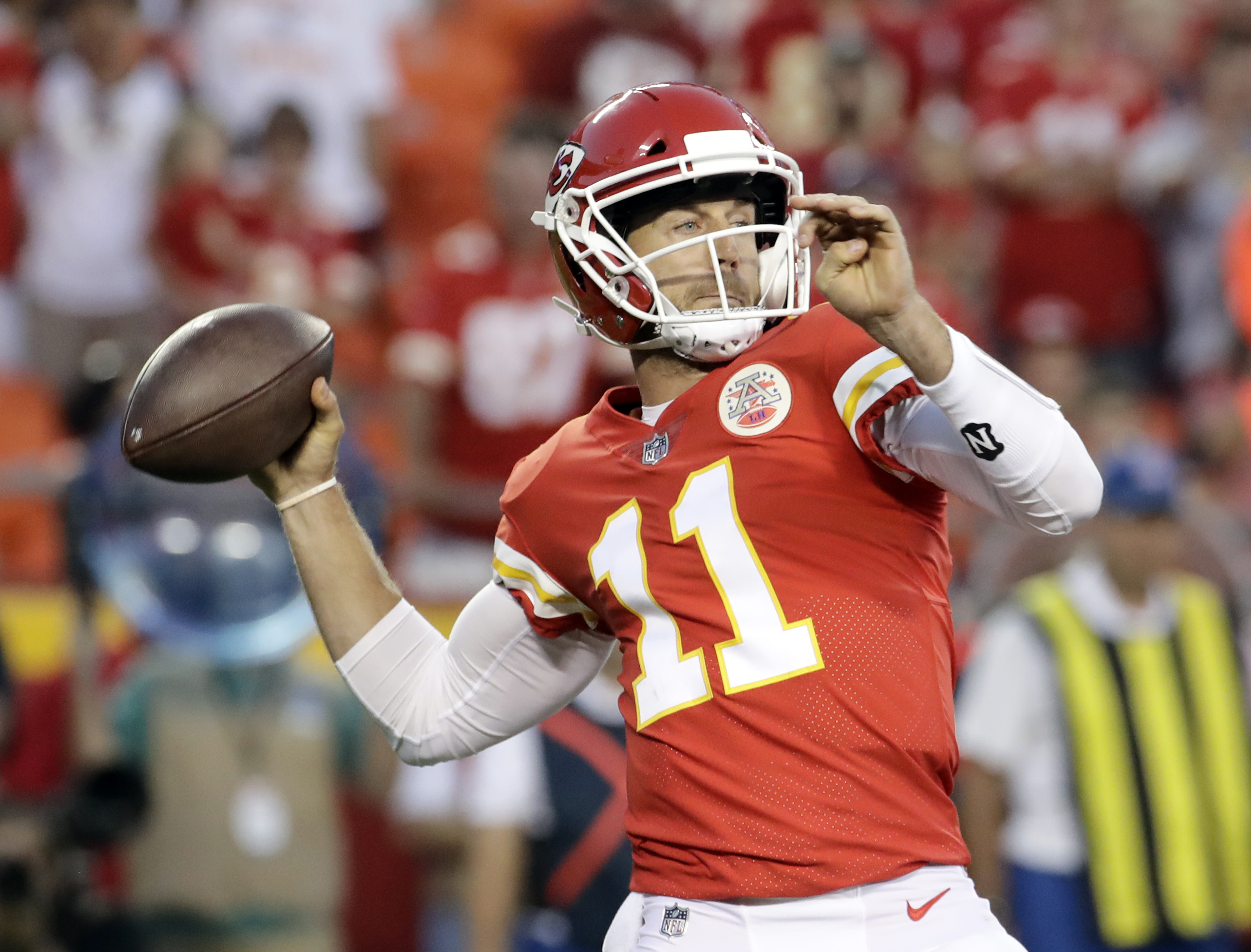 Kansas City Chiefs quarterback Alex Smith (11) throws during the first half of an NFL preseason football game against the San Francisco 49ers in Kansas City, Mo., Friday, Aug. 11, 2017. (AP Photo/Charlie Riedel)
