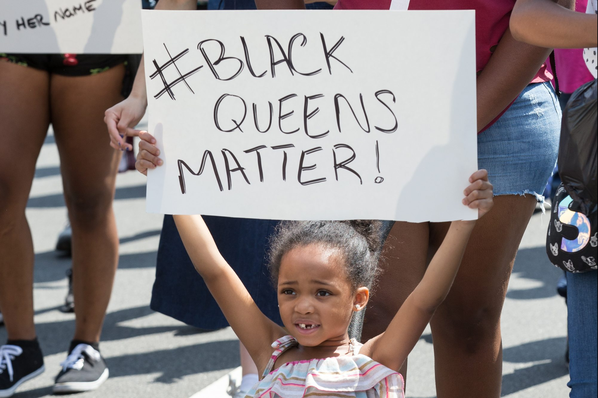 "Five-year-old Selena Reeves holds up a sign during ""A March For Black Women"" on Broad Street, the march started at City Hall and ended at Cecil B. Moore Ave., Friday, Aug. 25, 2017. JESSICA GRIFFIN / Staff Photographer"