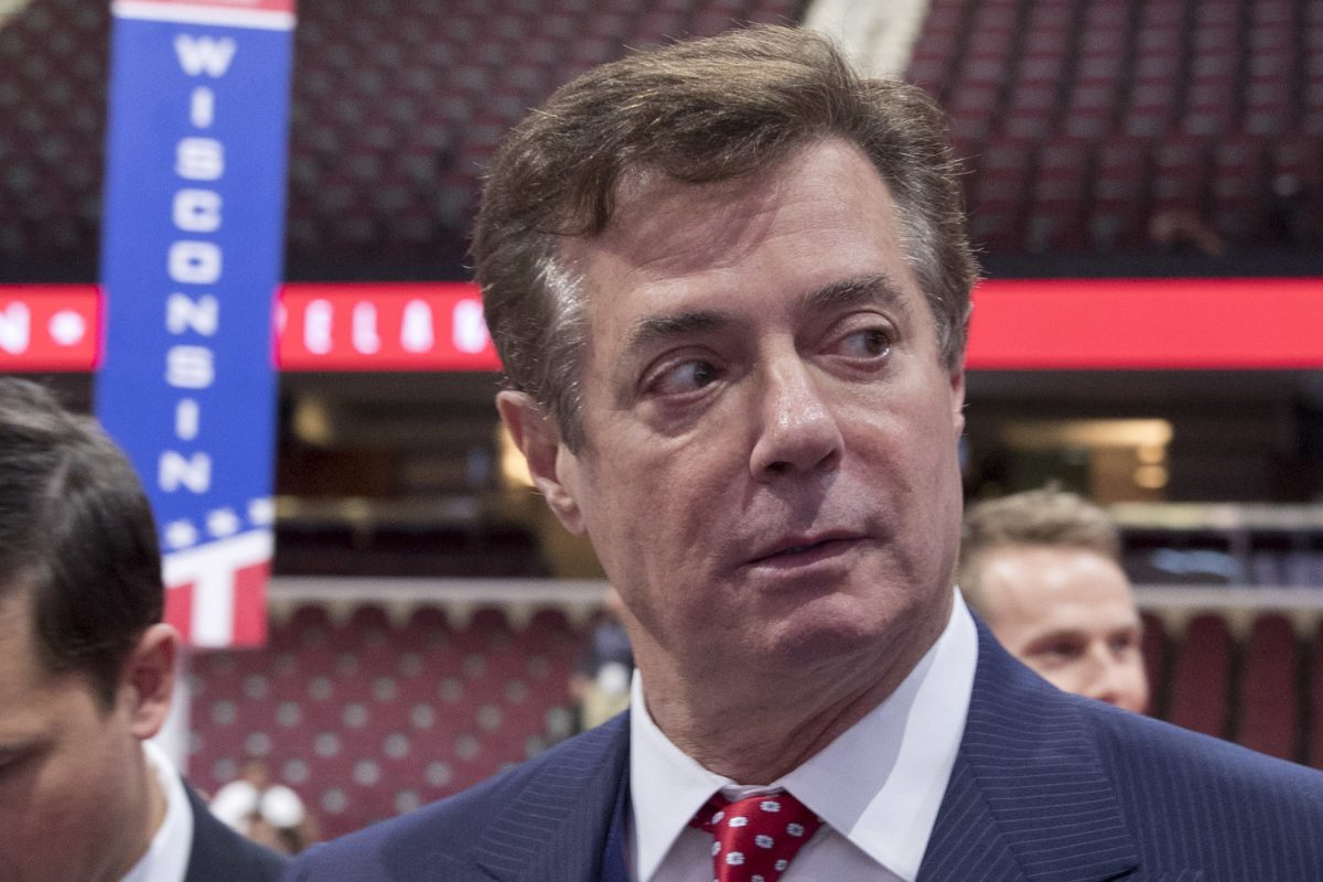 Paul Manafort, then Trump campaign chairman, walks around the convention floor before the opening session of the Republican National Convention in Cleveland last year.