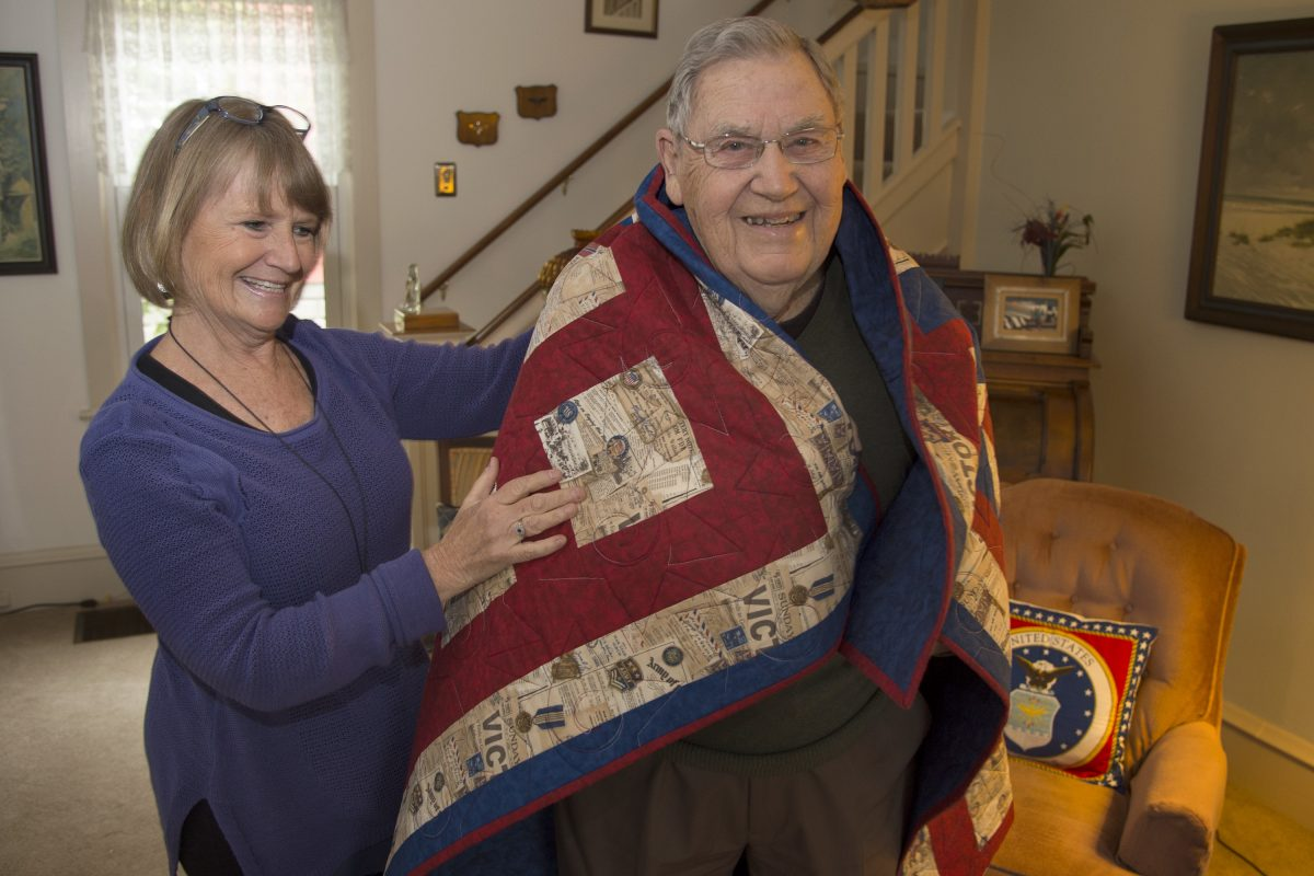 """Charles Osborne, 93,  a veteran of the Army Air Force in World War II,  with his daughter Patricia """"Patt"""" at his Laurel Springs home. He is wrapped in a Quilt of Valor, an honor he recently received for his wartime service."""