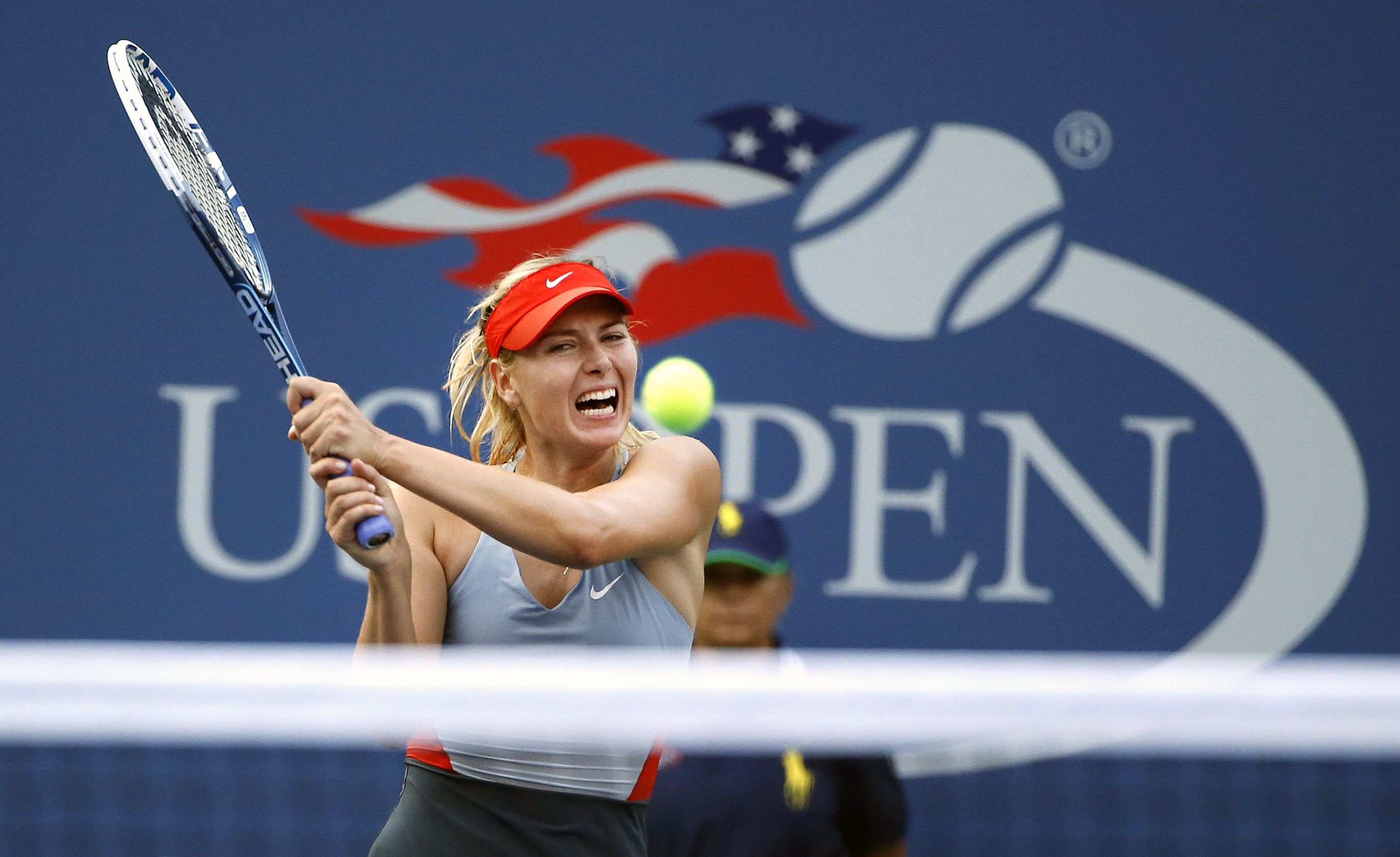 Maria Sharapova, of Russia, returns a shot to Alexandra Dulgheru, of Romania, during the second round of the U.S. Open tennis tournament Wednesday, Aug. 27, 2014, in New York. (AP Photo/Jason DeCrow)