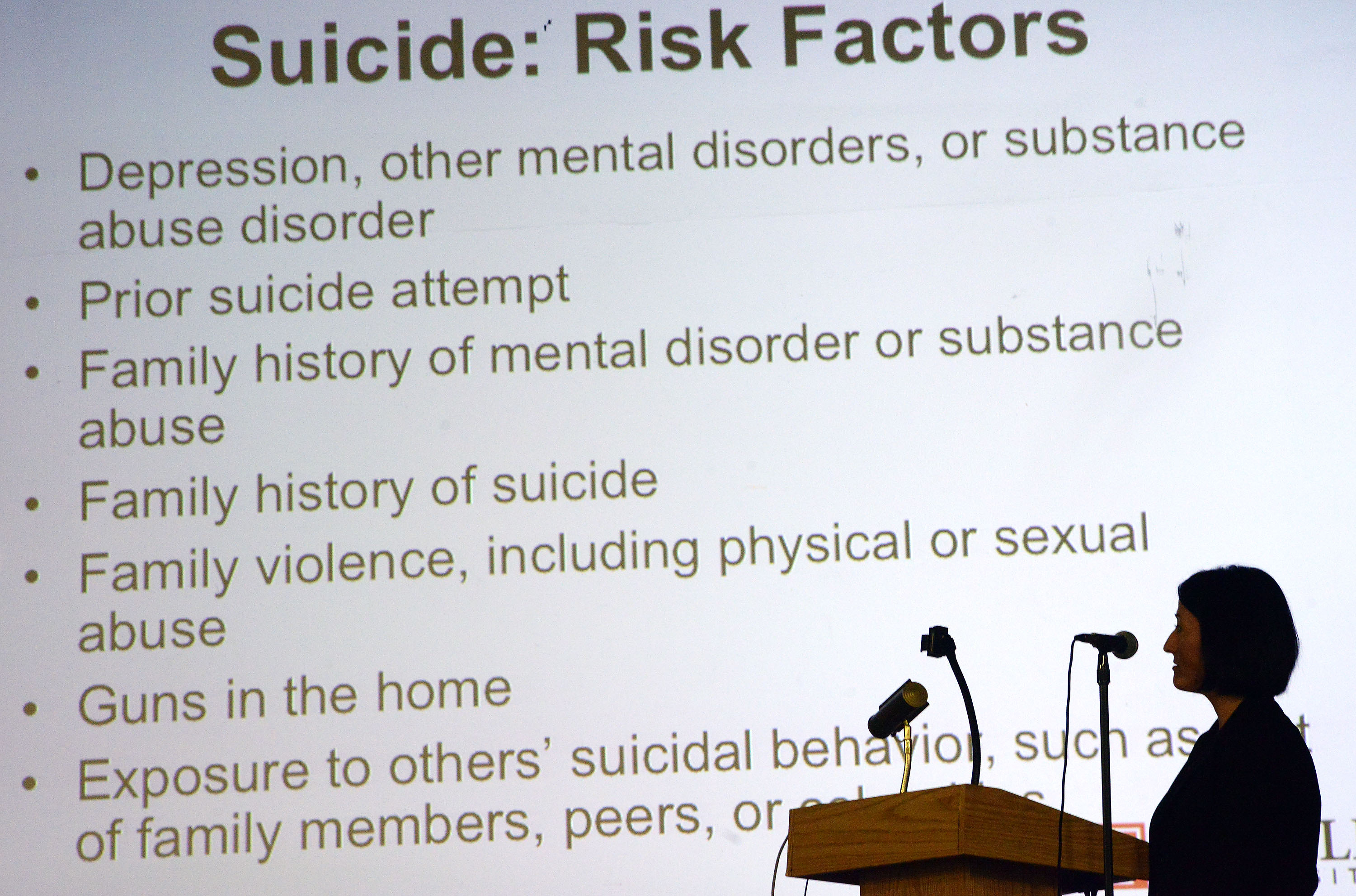 Ruby Barghini, a psychiatry resident at Temple University Hospital is silhouetted as she speaks about risk factors during a suicide prevention presentation for teachers and administrators Monday, August 28, 2017 at Prep Charter School in Philadelphia, Pennsylvania.(WILLIAM THOMAS CAIN / For The Philadelphia Inquirer)