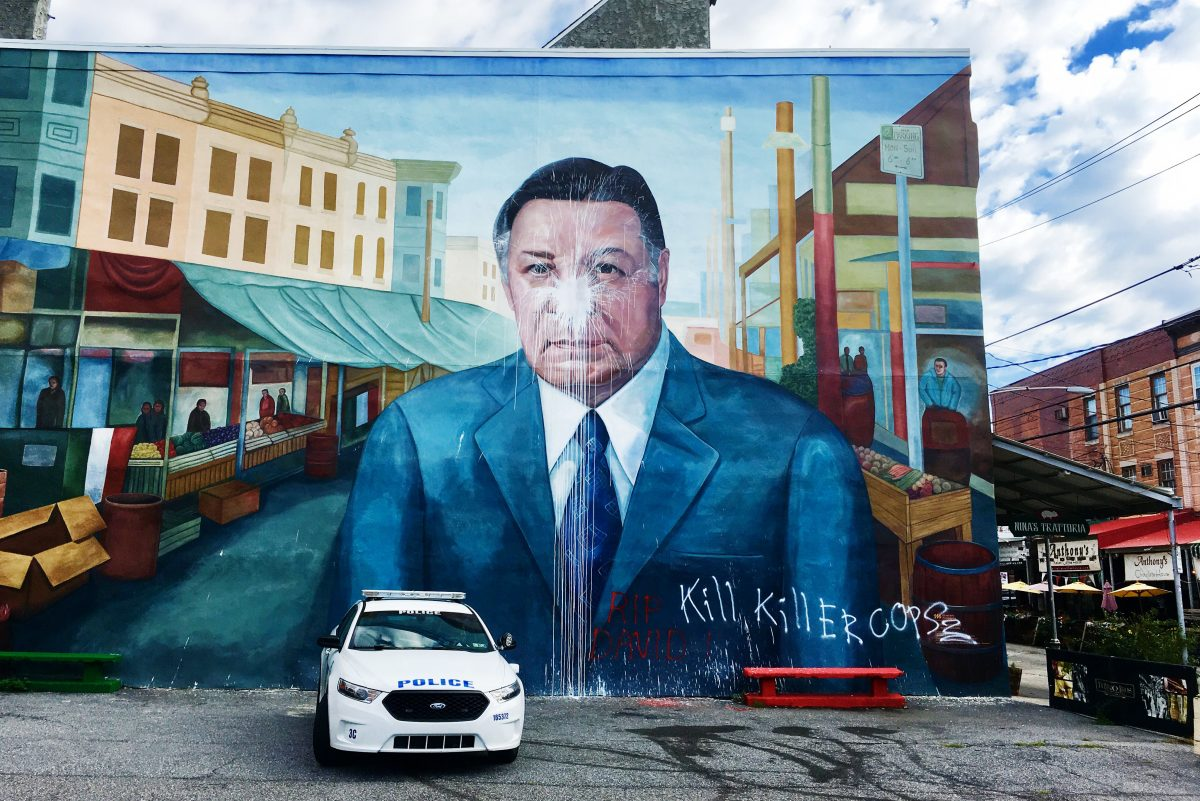 The Frank Rizzo mural after it was vandalized.