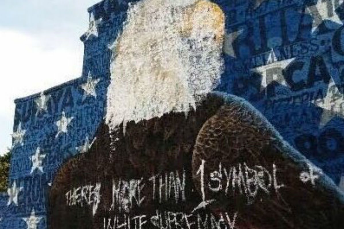Mural of American bald eagle defaced by vandals.