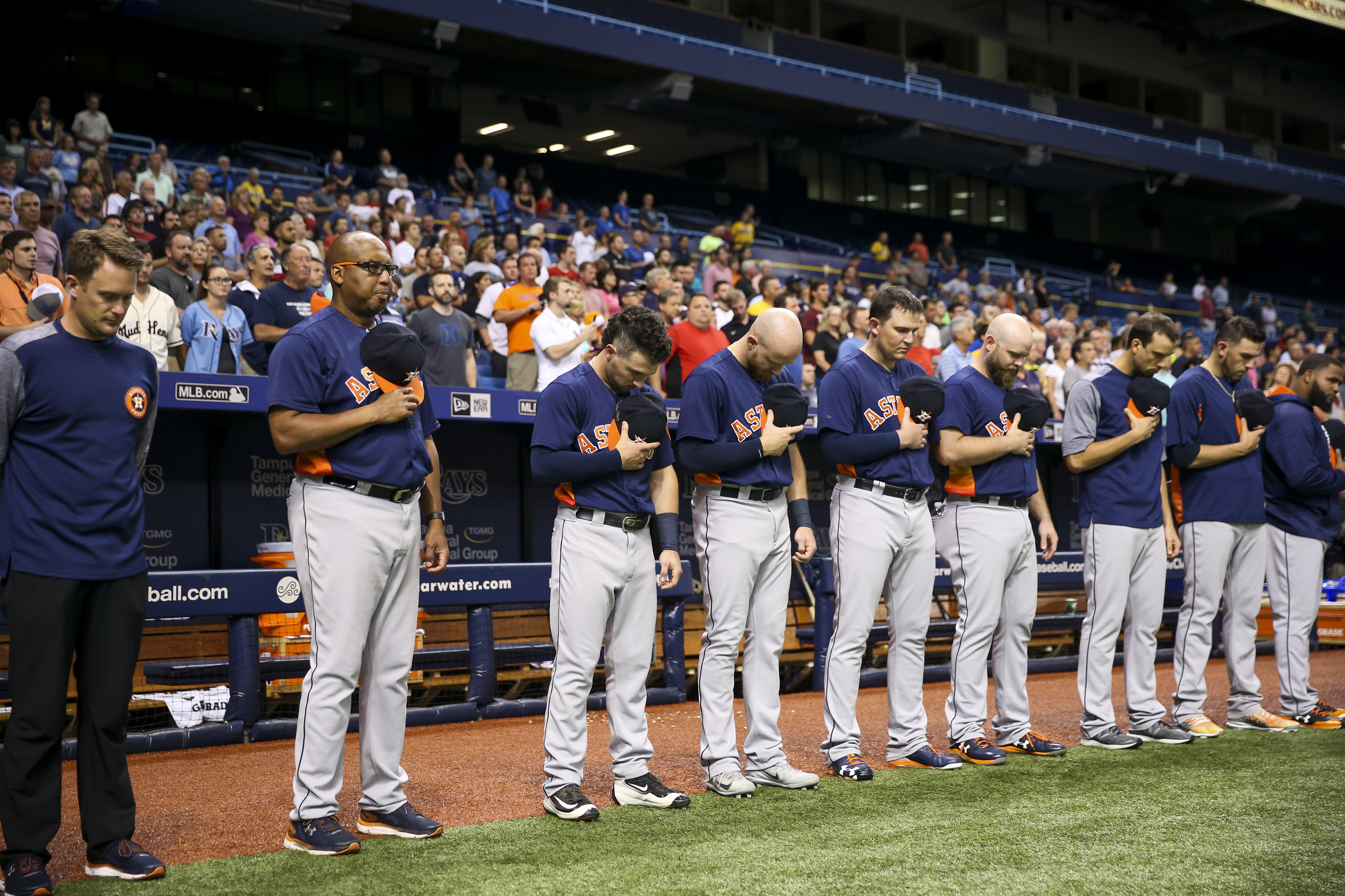 The Houston Astros pause for a moment of silence honoring the people of Houston, reeling from the effects of Hurricane Harvey, prior to a game against the Texas Rangers at Tropicana Field in St. Petersburg, Fla., on Tuesday, Aug. 29, 2017. (Will Vragovic/Tampa Bay Times/TNS)