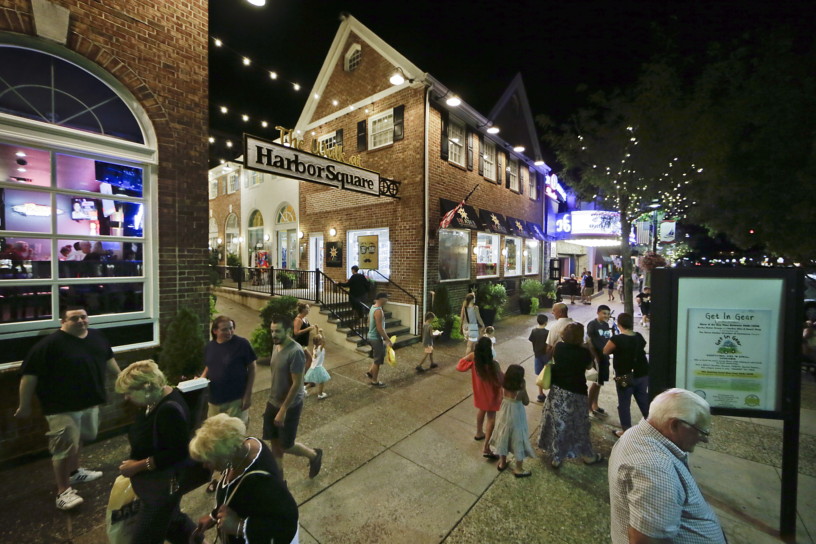 Lots of people out and about just before 9 pm at The Walk at Harbor Square (in foreground), the Harbor Square Theatre and Harbor Burger Bar (in background) on 96th St. in Stone Harbor on a recent evening