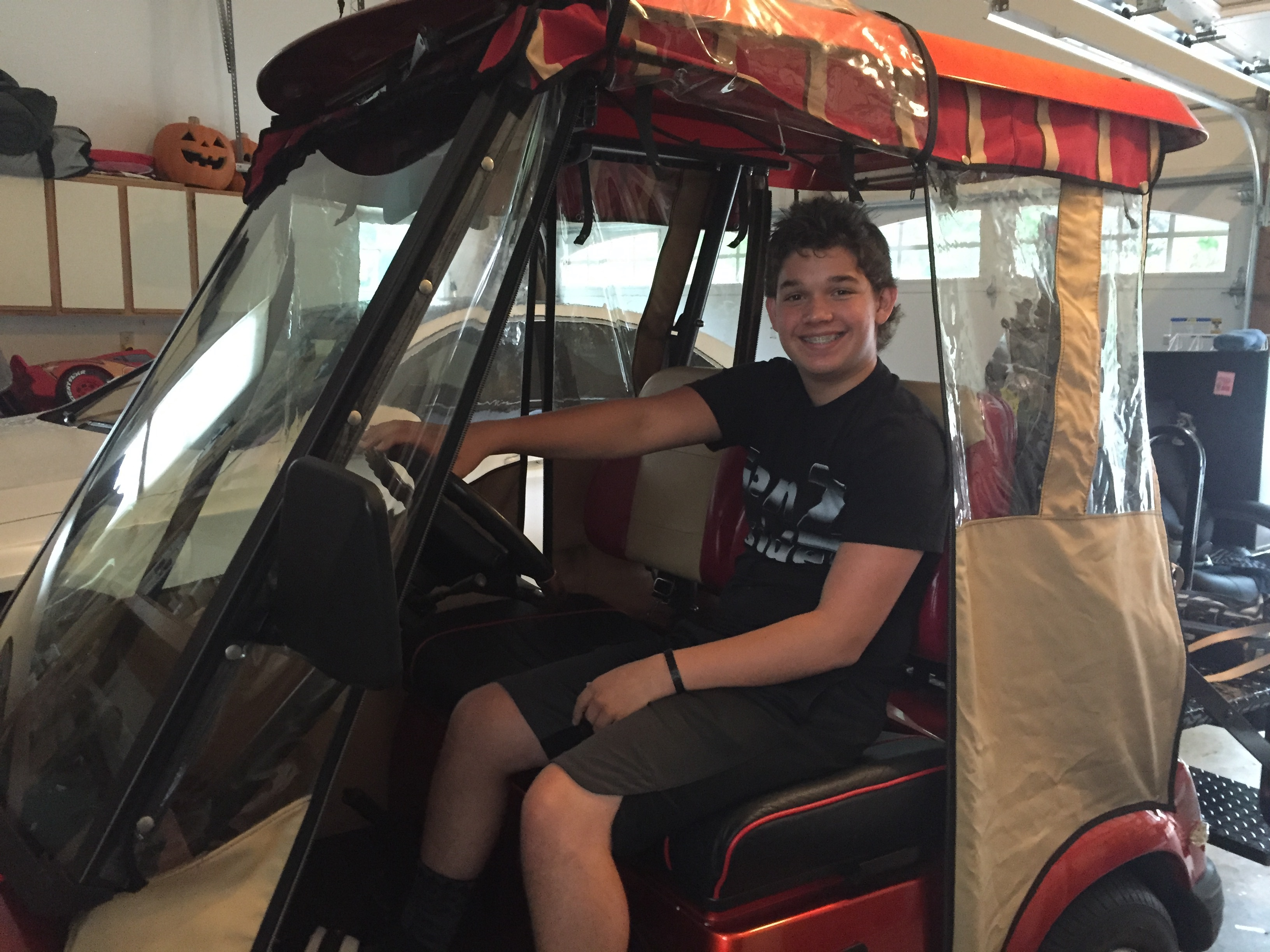 Sky Rota, 13, in a golf cart that he drives around his neighborhood in Cherry Hill. He has a Hummer version at the family´s Margate home (Kathy Boccella)